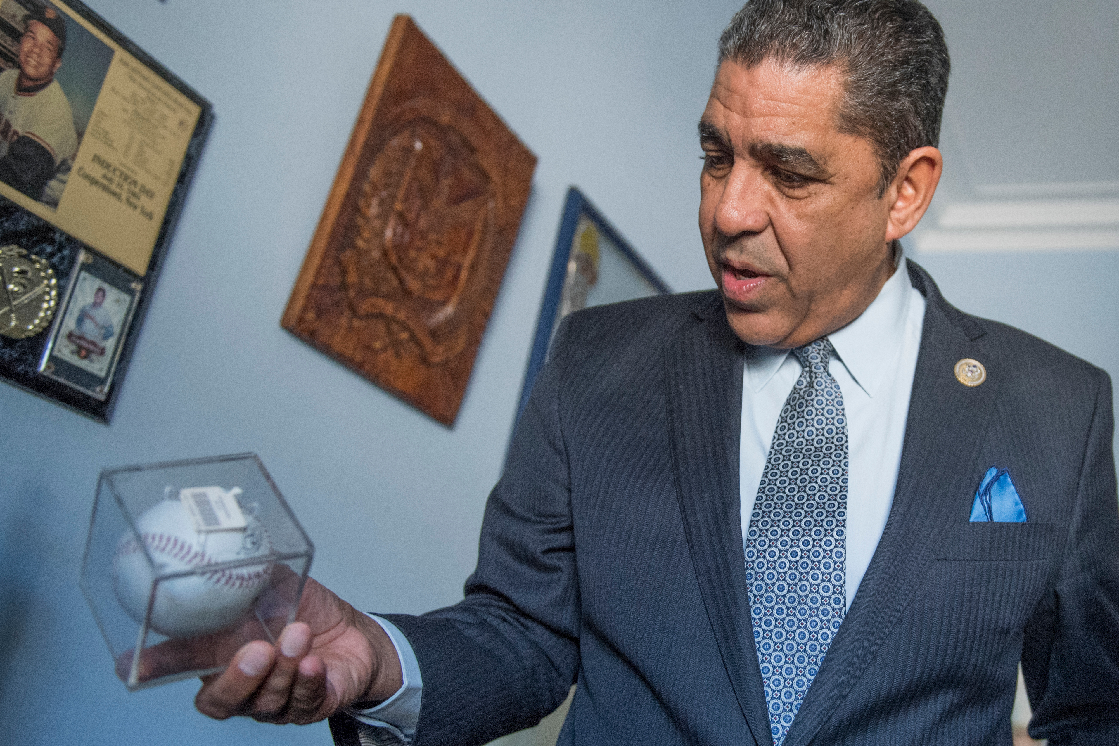 Rep. Adriano Espaillat, D-N.Y., is putting together a display of his baseball memorabilia in his Longworth office. (Tom Williams/CQ Roll Call)