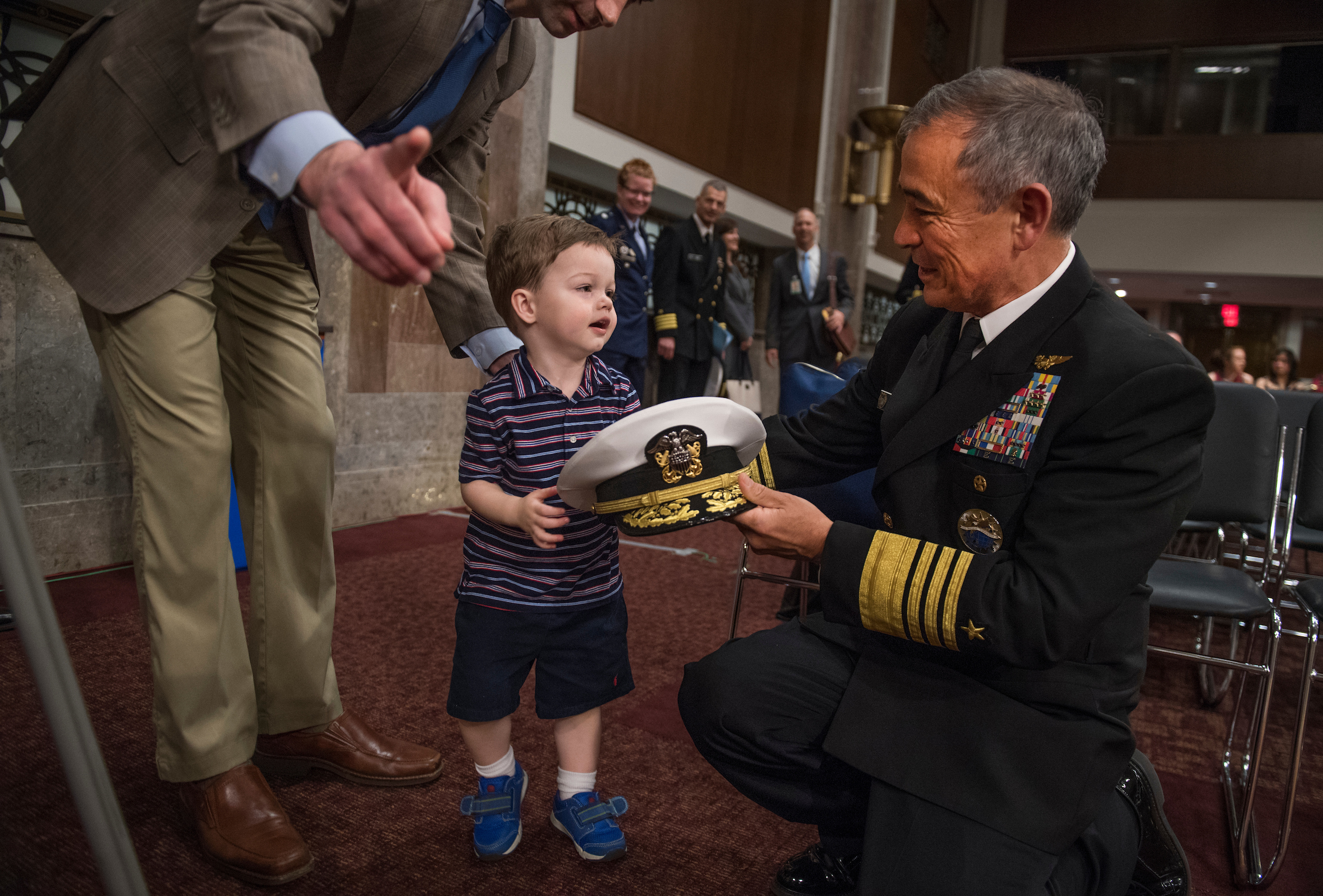 "UNITED STATES - APRIL 27: Navy Adm. Harry Harris Jr., commander of the U.S. Pacific Command, greets Sen. Tom Cotton, R-Ark., and his son Gabriel, 2, before Harris testified at a Senate Armed Services Committee hearing in Dirksen Building titled ""United States Pacific Command and United States Forces Korea,"" on April 27, 2017. Kids were on the Hill for Take Our Daughters and Sons to Work Day. (Photo By Tom Williams/CQ Roll Call)"