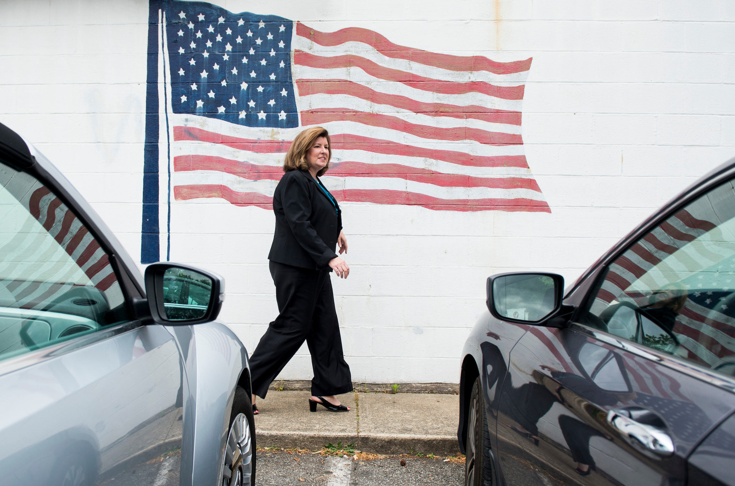 UNITED STATES - APRIL 17: Karen Handel, candidate for the Georgia 6th Congressional district, walks past an American flag as she arrives for a campaign stop at Rhea's restaurant in Roswell, Ga., on Monday, April 17, 2017, one day before the special election to fill Tom Price's seat . (Photo By Bill Clark/CQ Roll Call)