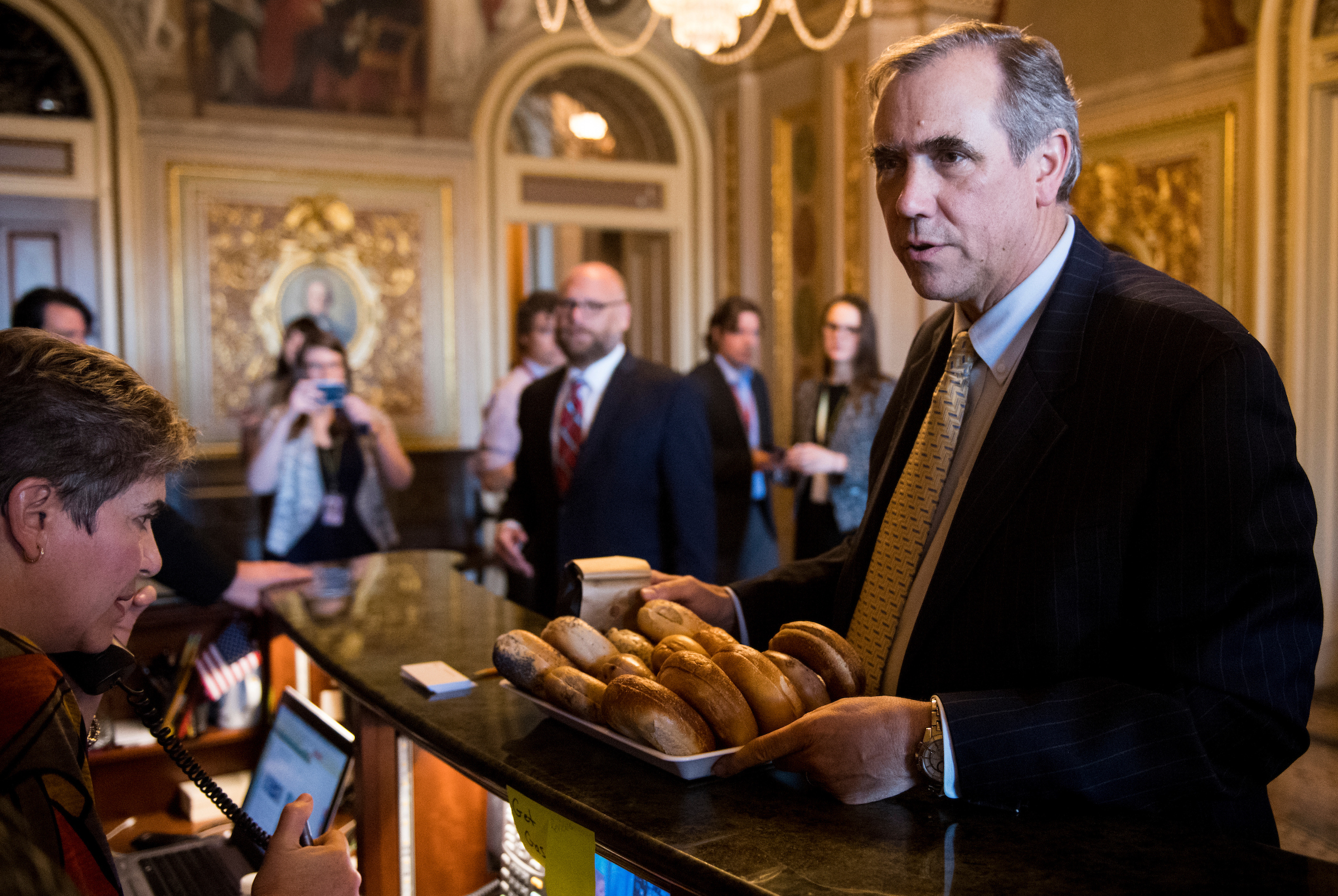 "Oregon Sen. <a class=""memberLink"" title=""Click to view member info in a new window"" href=""http://data.rollcall.com/members/28565?rel=memberLink"" target=""_blank"">Jeff Merkley</a> wrapped up his marathon floor speech Wednesday morning after more than 15 hours. He then distributed bagels and muffins to Senate staff following the all-nighter. (Bill Clark/CQ Roll Call)"