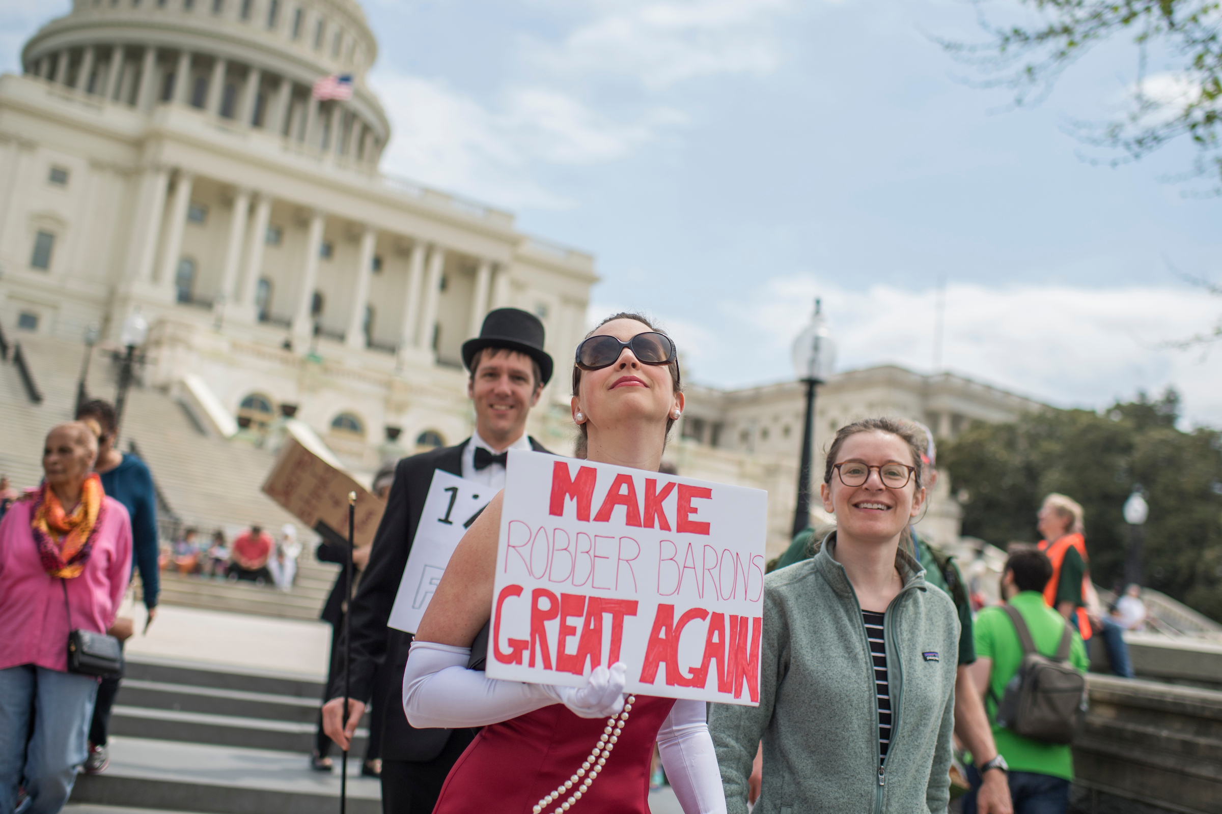 UNITED STATES - APRIL 15: People gather for the Tax March rally on the west lawn of the Capitol to call on President Trump to release his tax returns, April 15, 2017. (Photo By Tom Williams/CQ Roll Call)