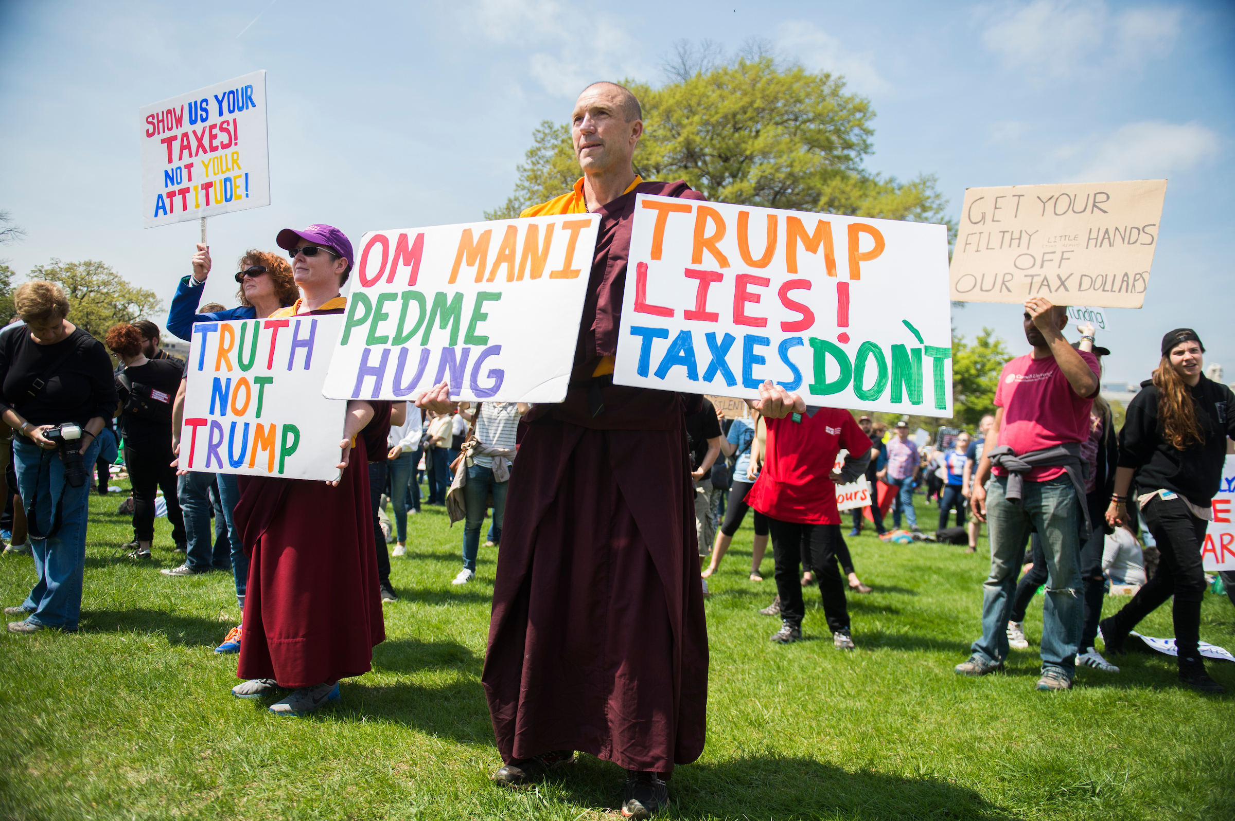 Buddhist monk Jampal Rowe of Poolesville, Md., attends the Tax March. (Tom Williams/CQ Roll Call)
