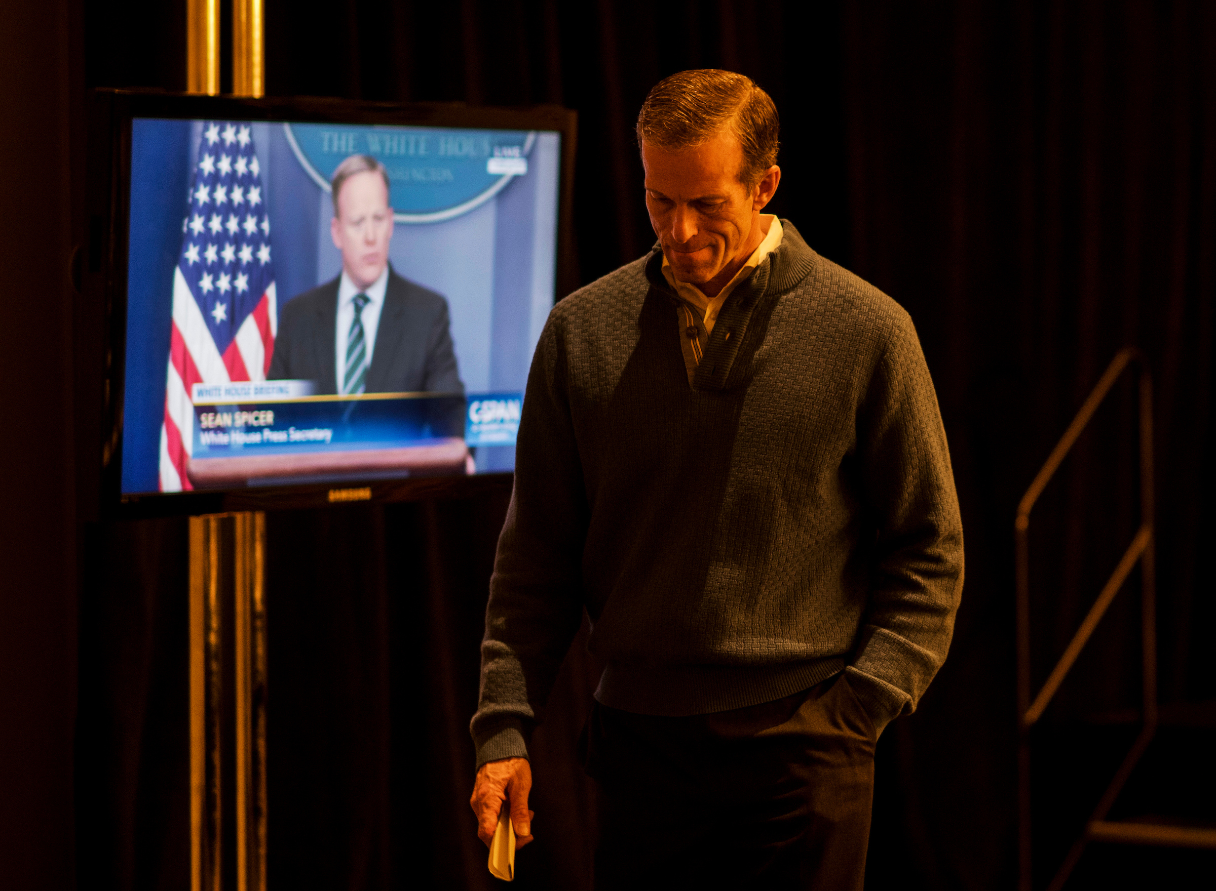 UNITED STATES - JANUARY 25: White House Press Secretary Sean Spicer's press briefing plays on C-SPAN as Senate Republican Conference chair John Thune, R-S. Dak., walks off stage following hismedia availability with House Republican Conference Chair Cathy McMorris Rodgers, R-Wash., at the GOP retreat in Philadelphia on Wednesday, Jan. 25, 2017. House and Senate Republicans are holding their retreat through Friday in Philadelphia, with a visit from President Donald Trump expected Thursday. (Photo By Bill Clark/CQ Roll Call)