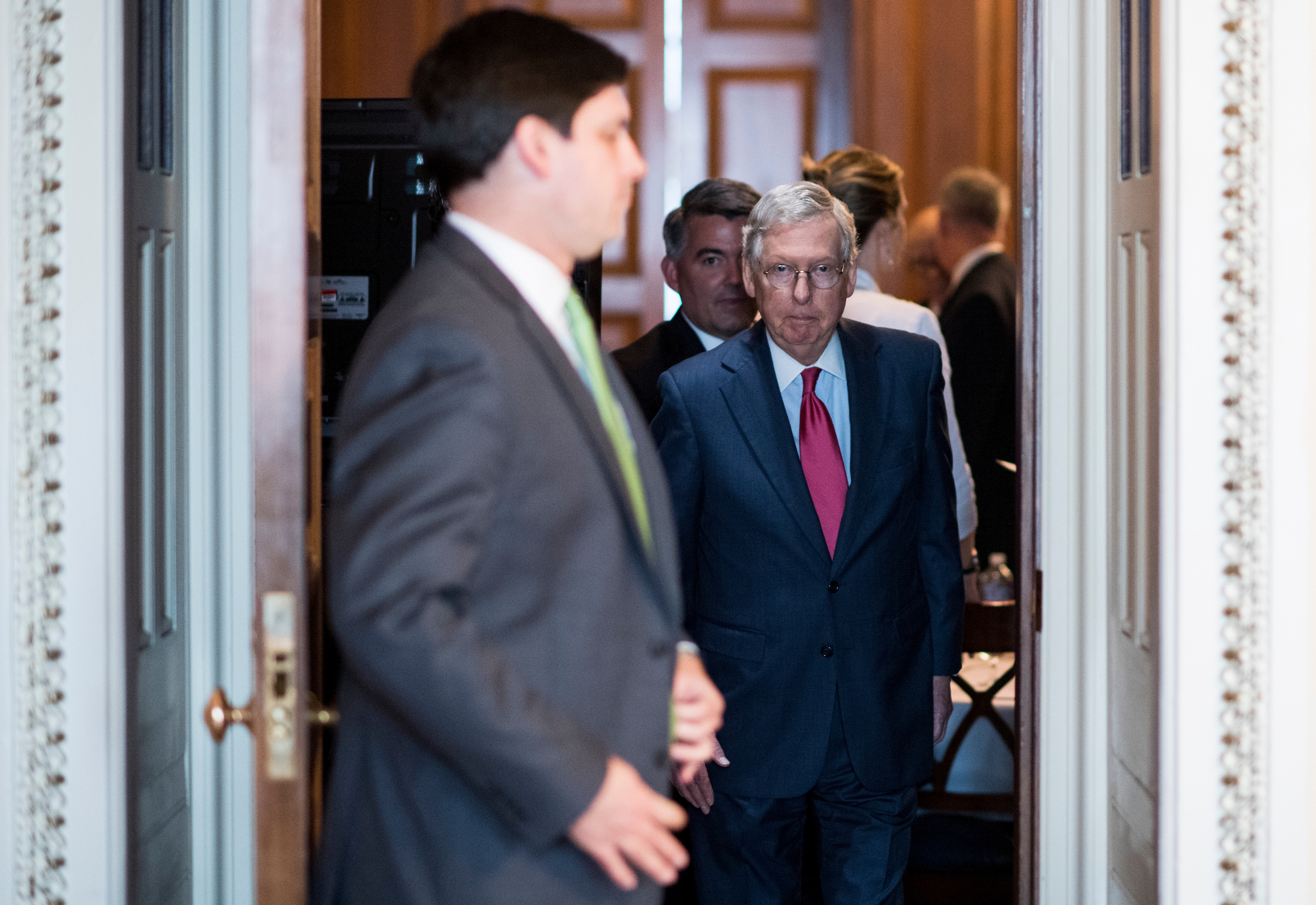 UNITED STATES - MAY 16: Senate Majority Leader Mitch McConnell, R-Ky., followed by Sen. Cory Gardner, R-Colo., walks to the podium in the Ohio Clock Corridor to face reporters after the Senate Republicans' policy lunch on Tuesday, May 16, 2017. (Photo By Bill Clark/CQ Roll Call)
