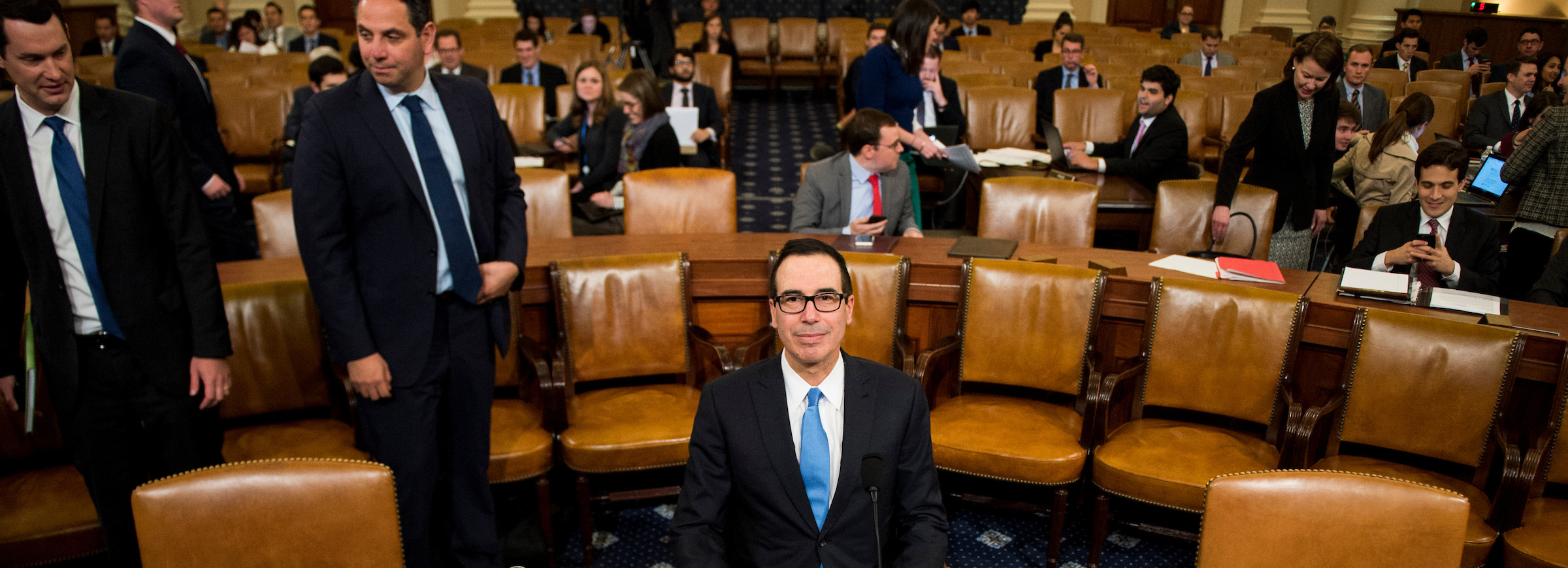 Treasury Secretary Steven Mnuchin takes his seat at the witness table before the start of the House Ways and Means Committee hearing on Trump''s budget proposals for fiscal 2018 on Wednesday. (Bill Clark/CQ Roll Call)