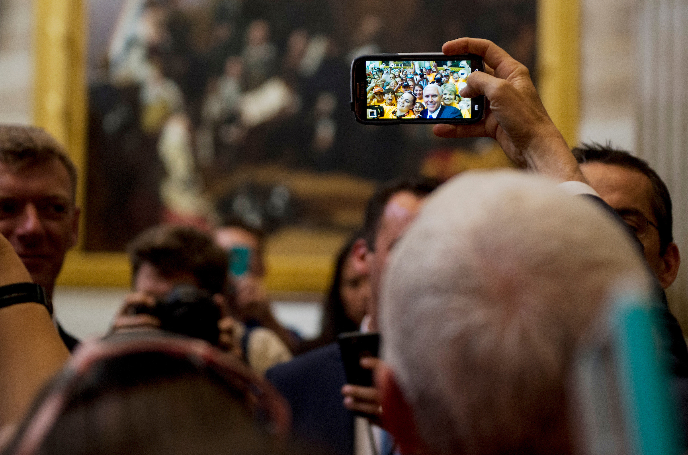 UNITED STATES - MAY 2: Vice President Mike Pence stops to take a selfie with a school group from Moultrie, Ga., in the U.S. Capitol Rotunda after leaving the Senate Republicans' policy lunch in the Capitol on Tuesday, May 2, 2017. (Photo By Bill Clark/CQ Roll Call)