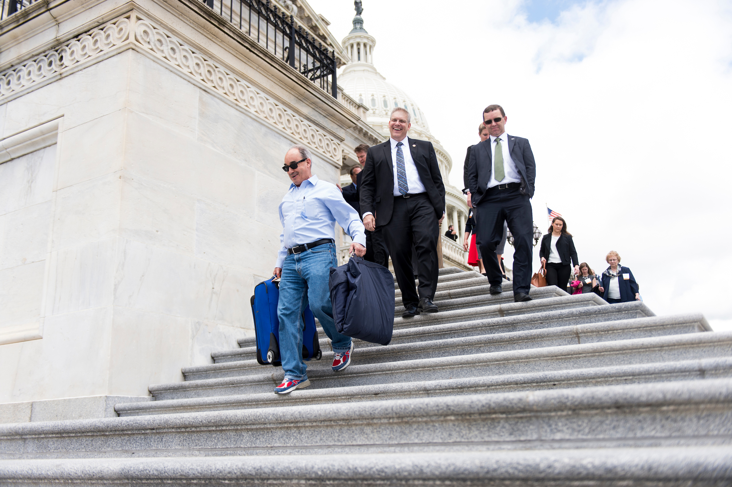 UNITED STATES - MAY 25: Rep. Bruce Poliquin, R-Maine, carries his luggage as he leaves the Capitol for the Memorial Day recess following the final votes of the week on Thursday, May 25, 2017. (Photo By Bill Clark/CQ Roll Call)