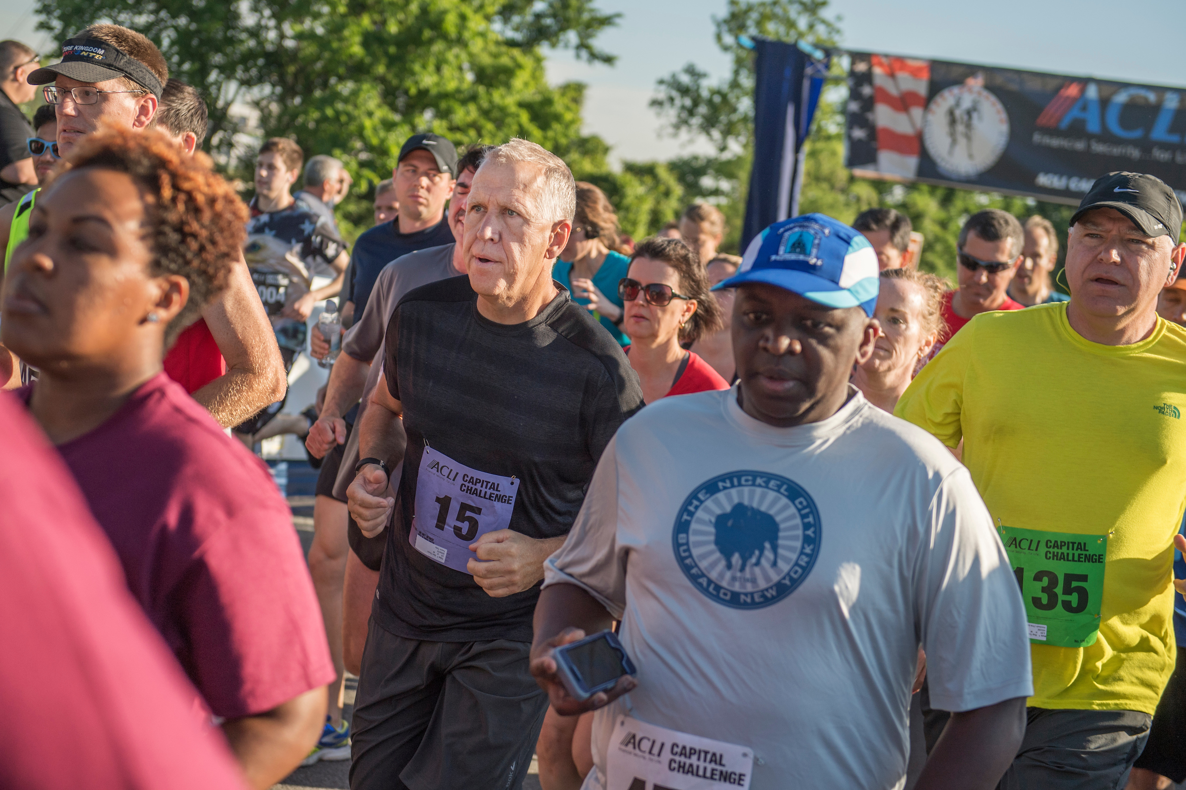 UNITED STATES - MAY 17: Sen. Thom Tillis, R-N.C., black shirt, and Rep. Tim Walz, D-Minn., yellow shirt, run in the ACLI Capital Challenge 3 Mile Team Race in Anacostia Park, May 17, 2017. Tillis reportedly collapsed later in the race. (Photo By Tom Williams/CQ Roll Call)