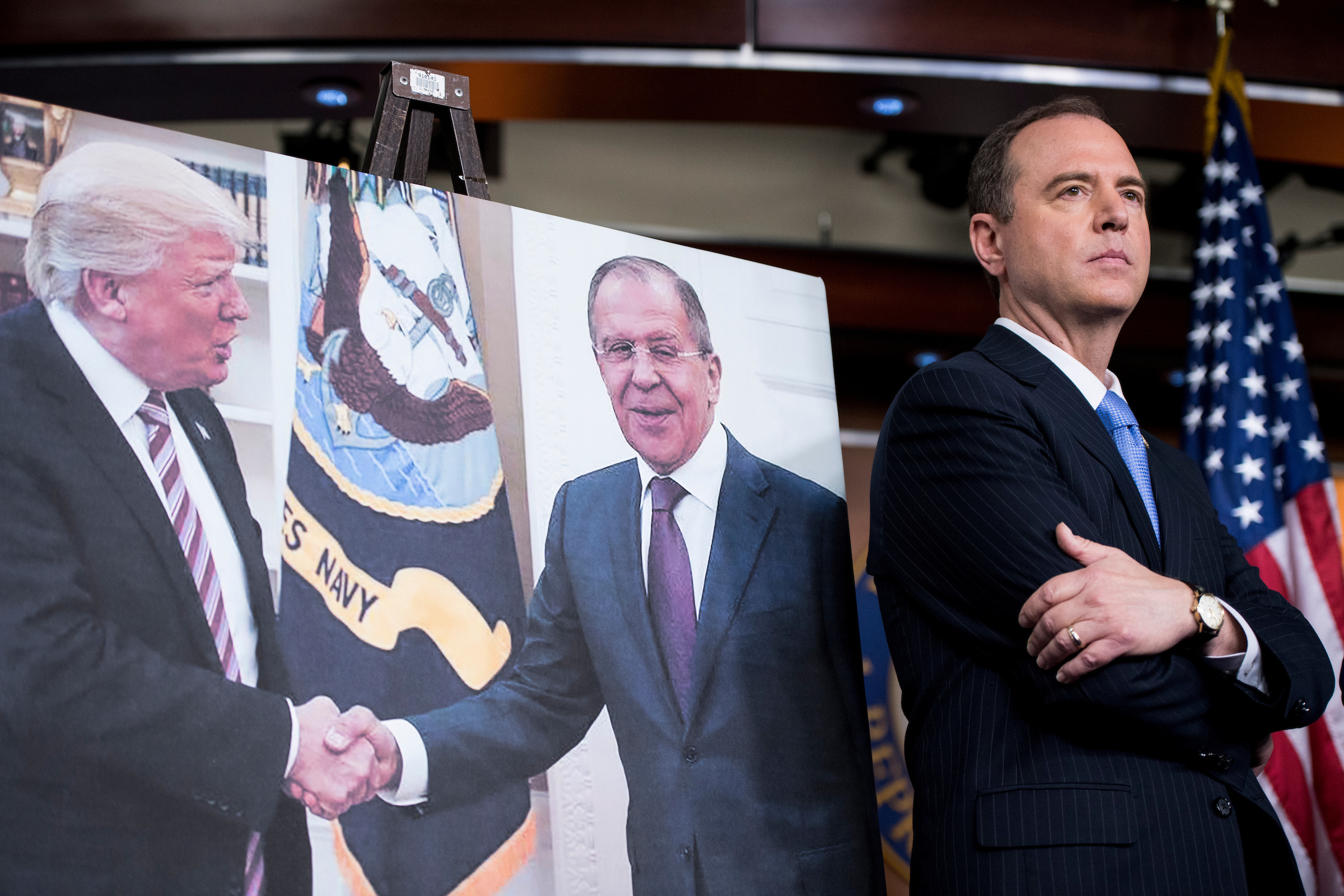 UNITED STATES - MAY 17: House Intelligence ranking member Adam Schiff, D-Calif., stands next to a photo of President Donald Trump in the Oval Office shaking hands with Russian Foreign Minister Sergey Lavrov during the House Democrats' news conference on President Trump and Russia ties on Wednesday, May 17, 2017. (Photo By Bill Clark/CQ Roll Call)