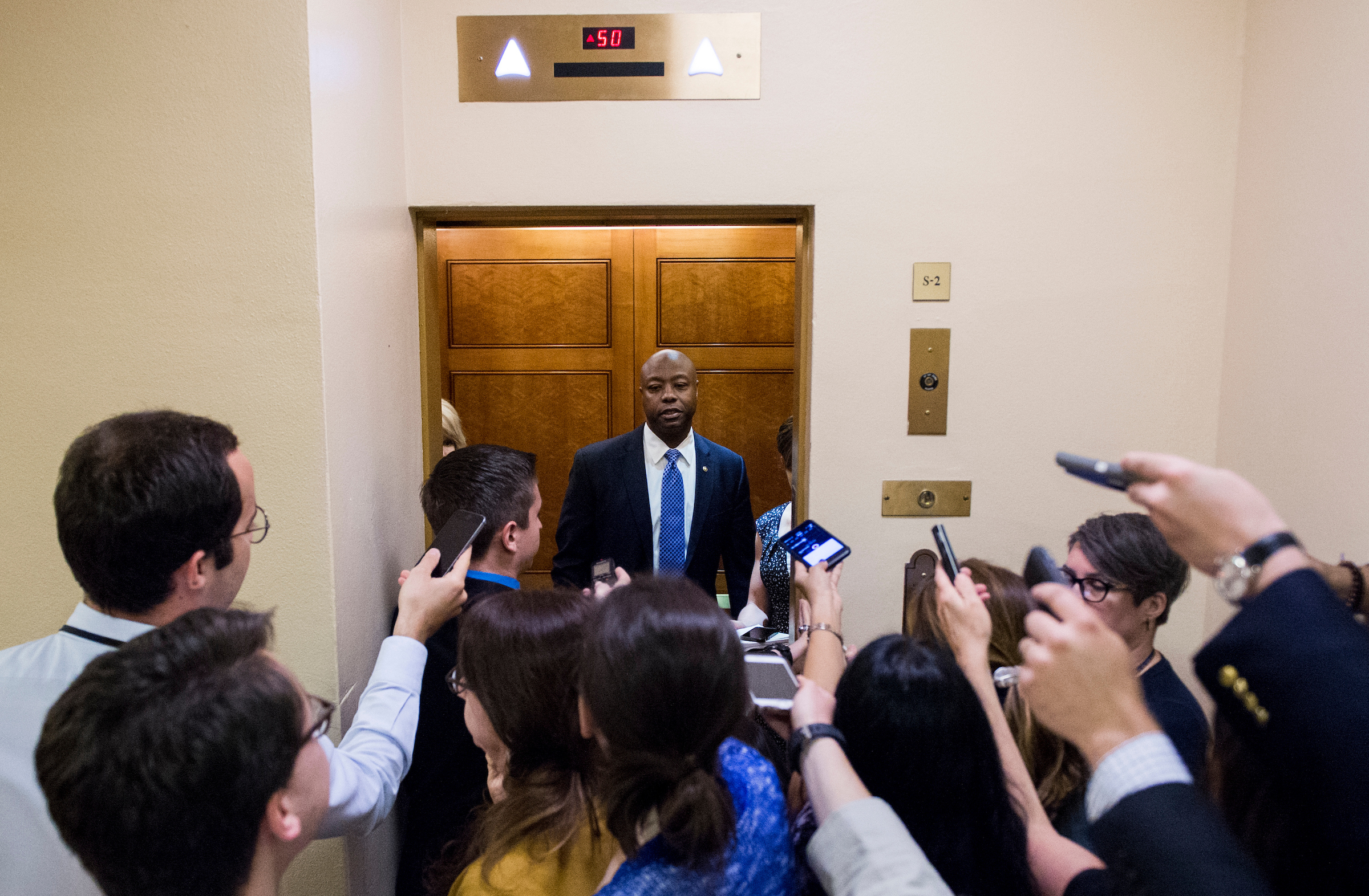 UNITED STATES - MAY 16: Reporters ask Sen. Tim Scott, R-S.C., questions as he arrives in the Capitol for the Senate Republicans' policy lunch on Tuesday, May 16, 2017. (Photo By Bill Clark/CQ Roll Call)
