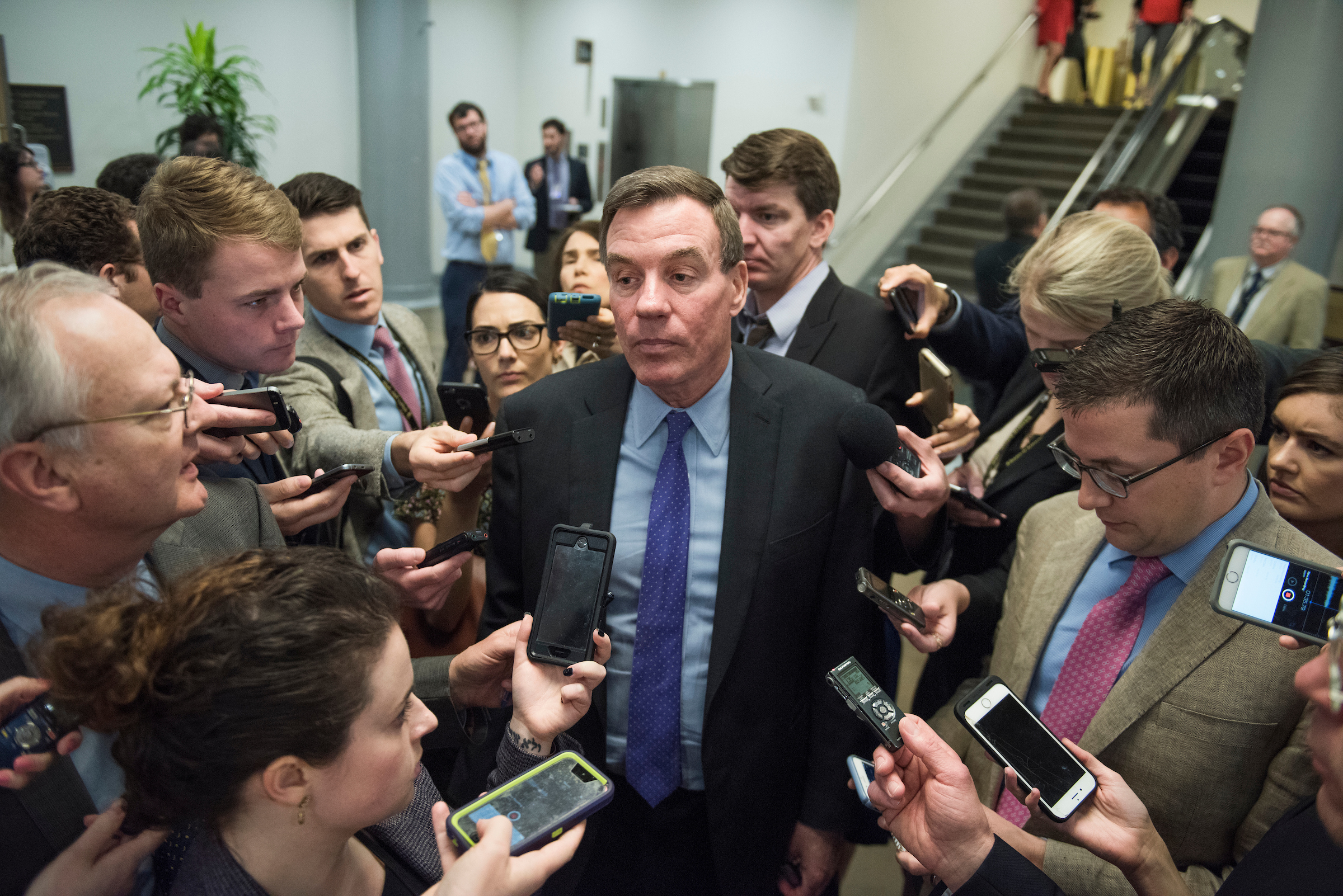UNITED STATES - MAY 17: Sen. Mark Warner, D-Va., talks with reporters in the senate subway before a vote in the Capitol on May 17, 2017. (Photo By Tom Williams/CQ Roll Call)