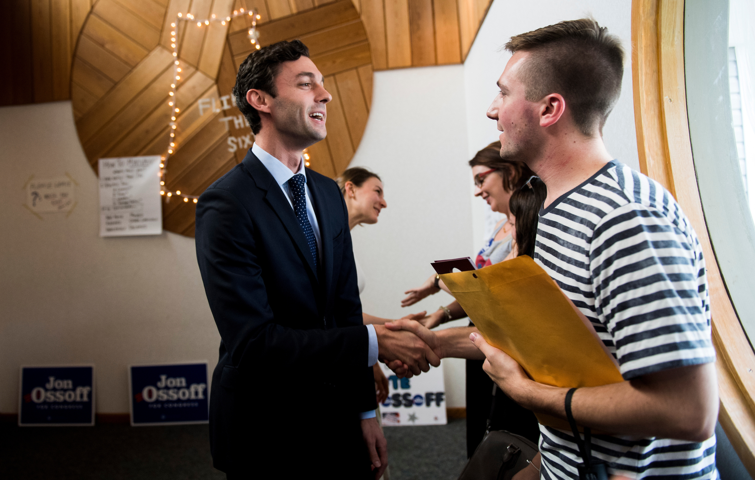 "UNITED STATES - JUNE 18: Democratic candidate for Georgia's 6th Congressional district Jon Ossoff shakes hands with campaign workers and volunteers at his ""Father's Day Canvass Launch"" at the Ossoff campaign office in Sandy Spring, Ga., on Sunday, June 18, 2017. Ossify is facing Republican Karen Handel in the special election to fill the seat vacated by current HHS Secretary Tom Price will be held on Tuesday. (Photo By Bill Clark/CQ Roll Call)"