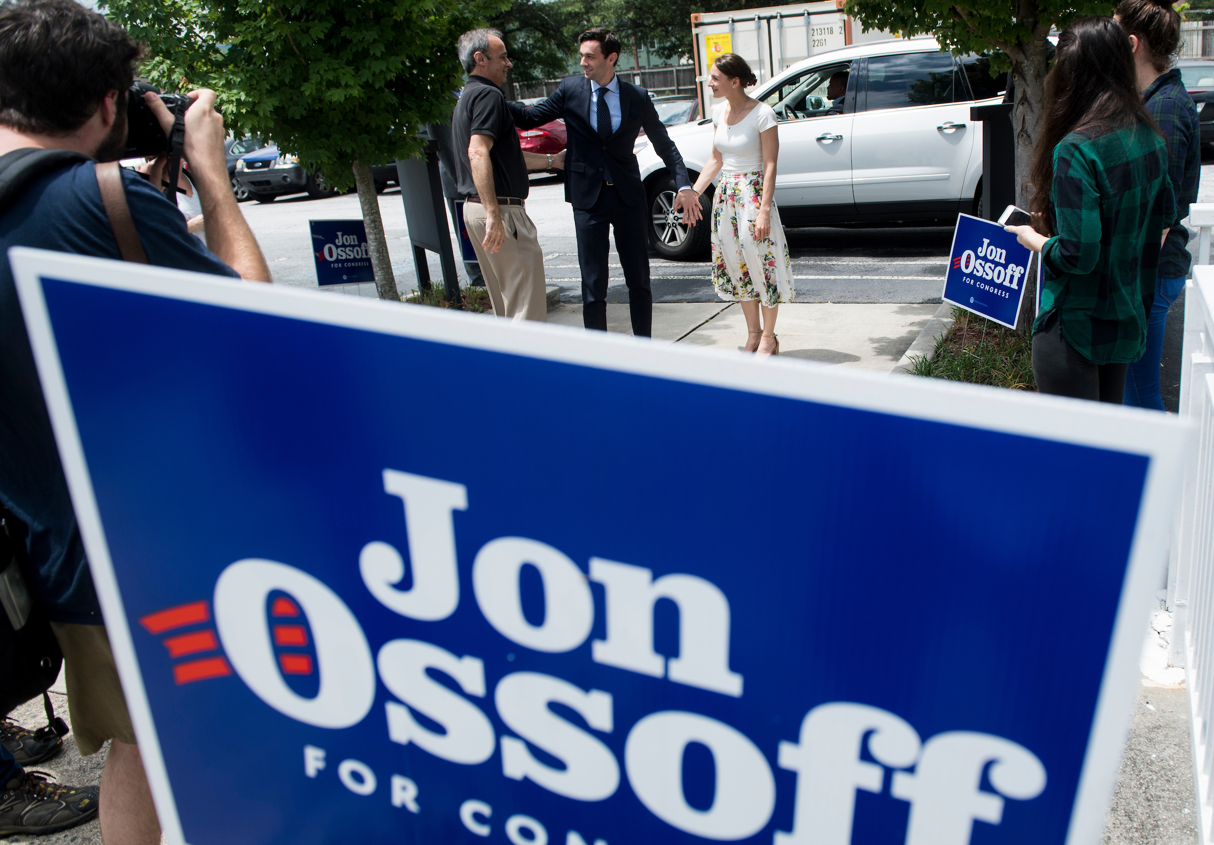 "UNITED STATES - JUNE 18: Democratic candidate for Georgia's 6th Congressional district Jon Ossoff, center, arrives with his father Richard Ossoff and his fiancee Alisha Kramer for his ""Father's Day Canvass Launch"" at the Ossoff campaign office in Sandy Spring, Ga., on Sunday, June 18, 2017. Ossify is facing Republican Karen Handel in the special election to fill the seat vacated by current HHS Secretary Tom Price will be held on Tuesday. (Photo By Bill Clark/CQ Roll Call)"