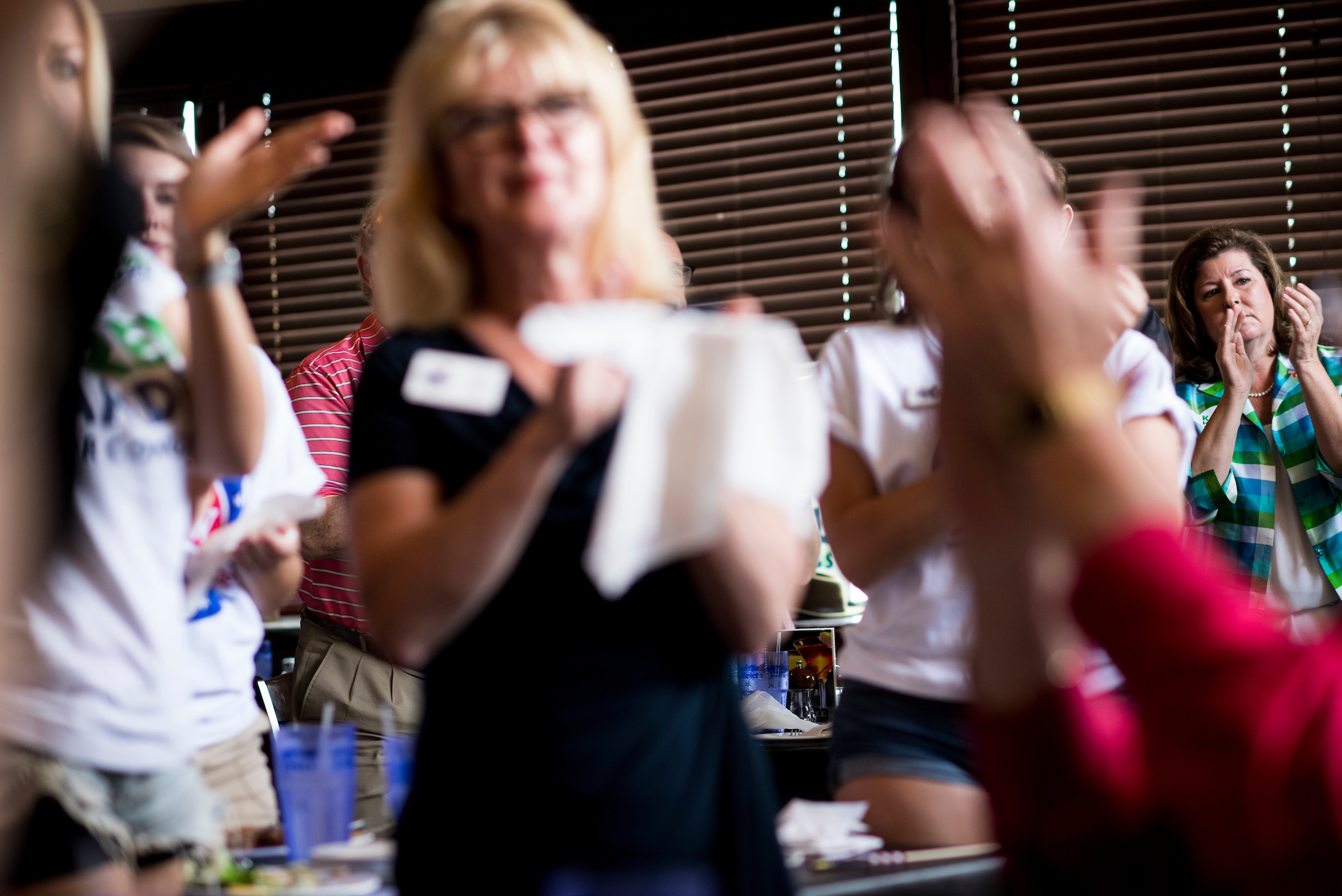 UNITED STATES - JUNE 19: Republican candidate for Georgia's 6th Congressional district Karen Handel claps during a rally with supporters at the Cherokee Cattle Ranch restaurant in Marietta, Ga., on the final day of campaigning on Monday, June 19, 2017. Handel is facing off against Democrat Jon Ossoff in the special election to fill the seat vacated by current HHS Secretary Tom Price will be held on Tuesday. (Photo By Bill Clark/CQ Roll Call)