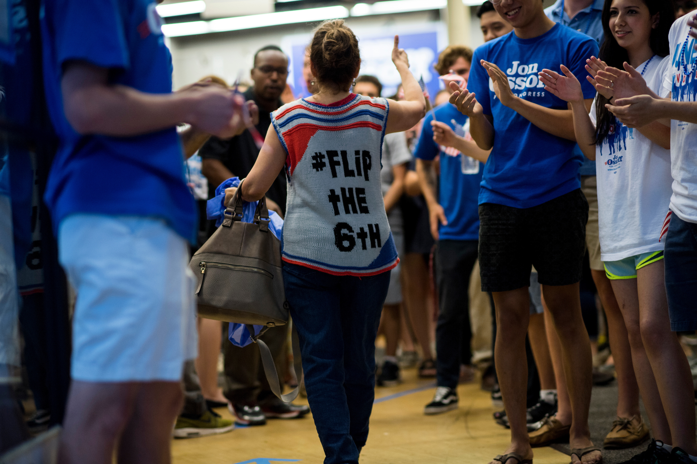 UNITED STATES - JUNE 19: Campaign workers cheer as fellow campaign workers arrive for the final campaign rally for Democratic candidate for Georgia's 6th Congressional district Jon Ossoff at his campaign office in Roswell, Ga., on the final day of campaigning on Monday, June 19, 2017. Ossoff is facing off against Republican Karen Handel in the special election to fill the seat vacated by current HHS Secretary Tom Price will be held on Tuesday. (Photo By Bill Clark/CQ Roll Call)