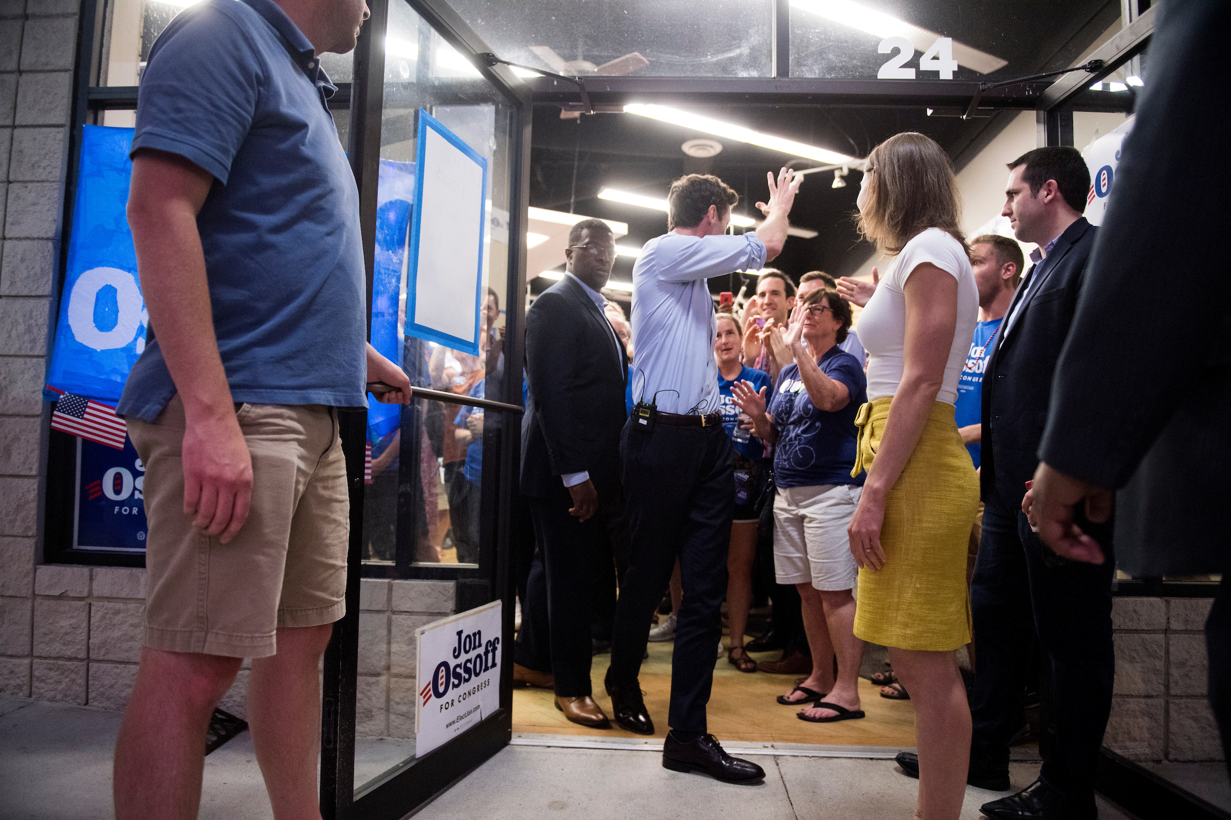 Ossoff waves to supporters as he and his his fiancee Alisha Kramer leave his final campaign rally at his campaign office in Roswell, Ga., on the final day of campaigning on Monday. (Bill Clark/CQ Roll Call)
