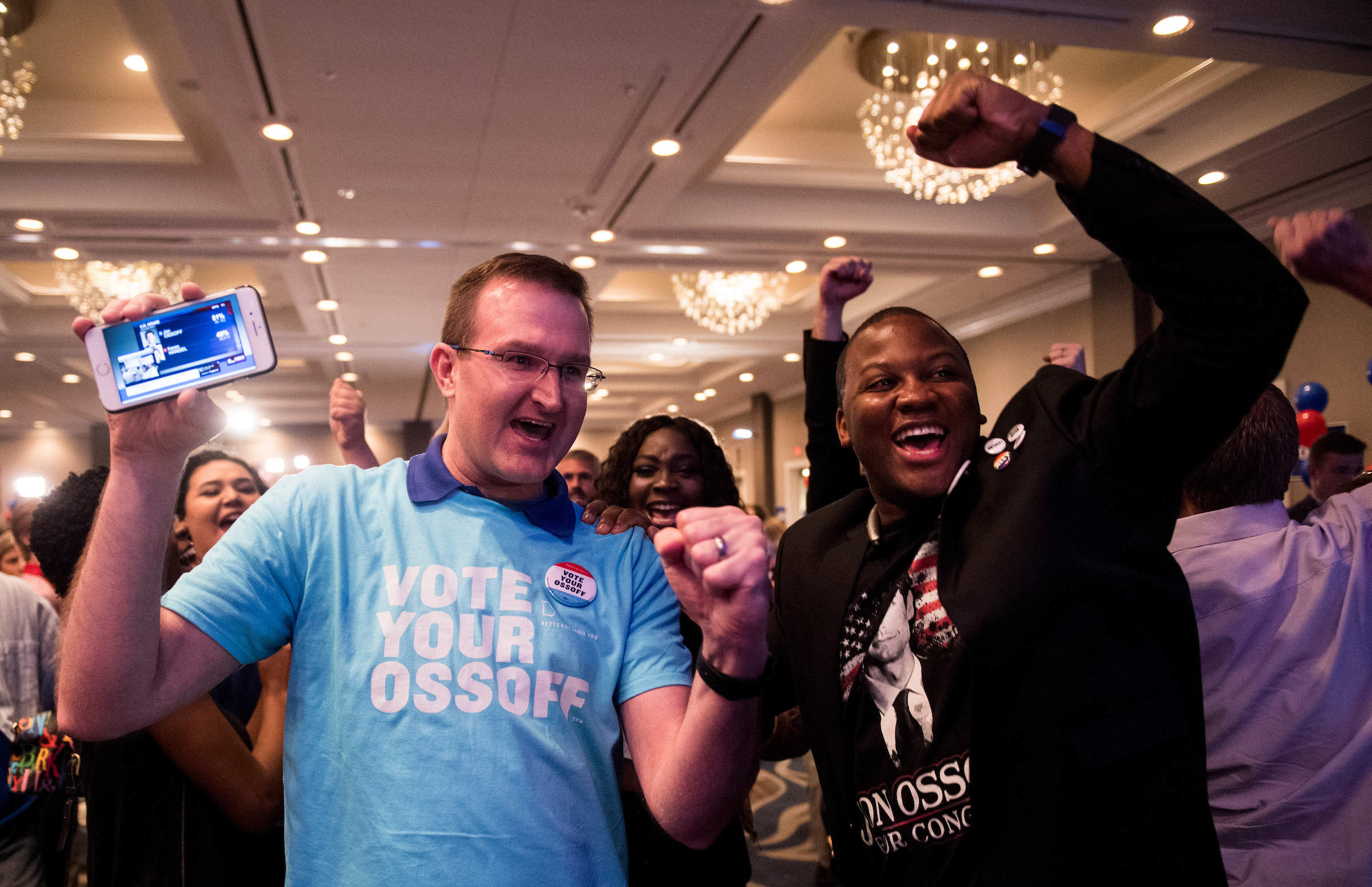 Ossoff supporters cheer early elections results at Ossoff's election night watch party in Atlanta, Ga., on special election day. (Bill Clark/CQ Roll Call)