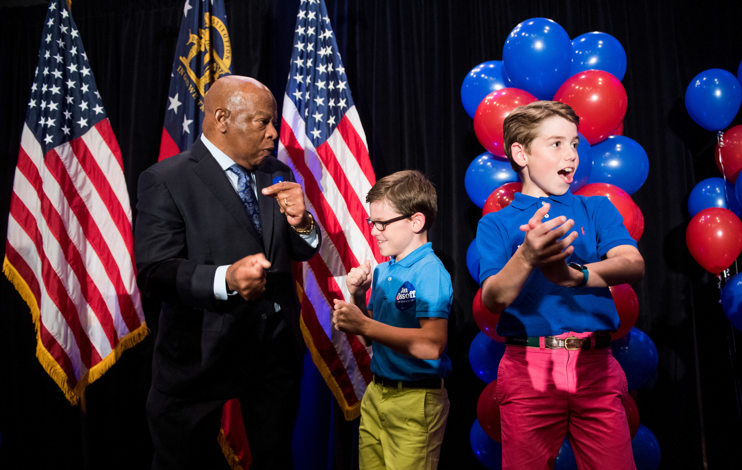 Rep. John Lewis, D-Ga., dances with children on stage before he spoke at Jon Ossoff's campaign rally on election night (Bill Clark/CQ Roll Call)