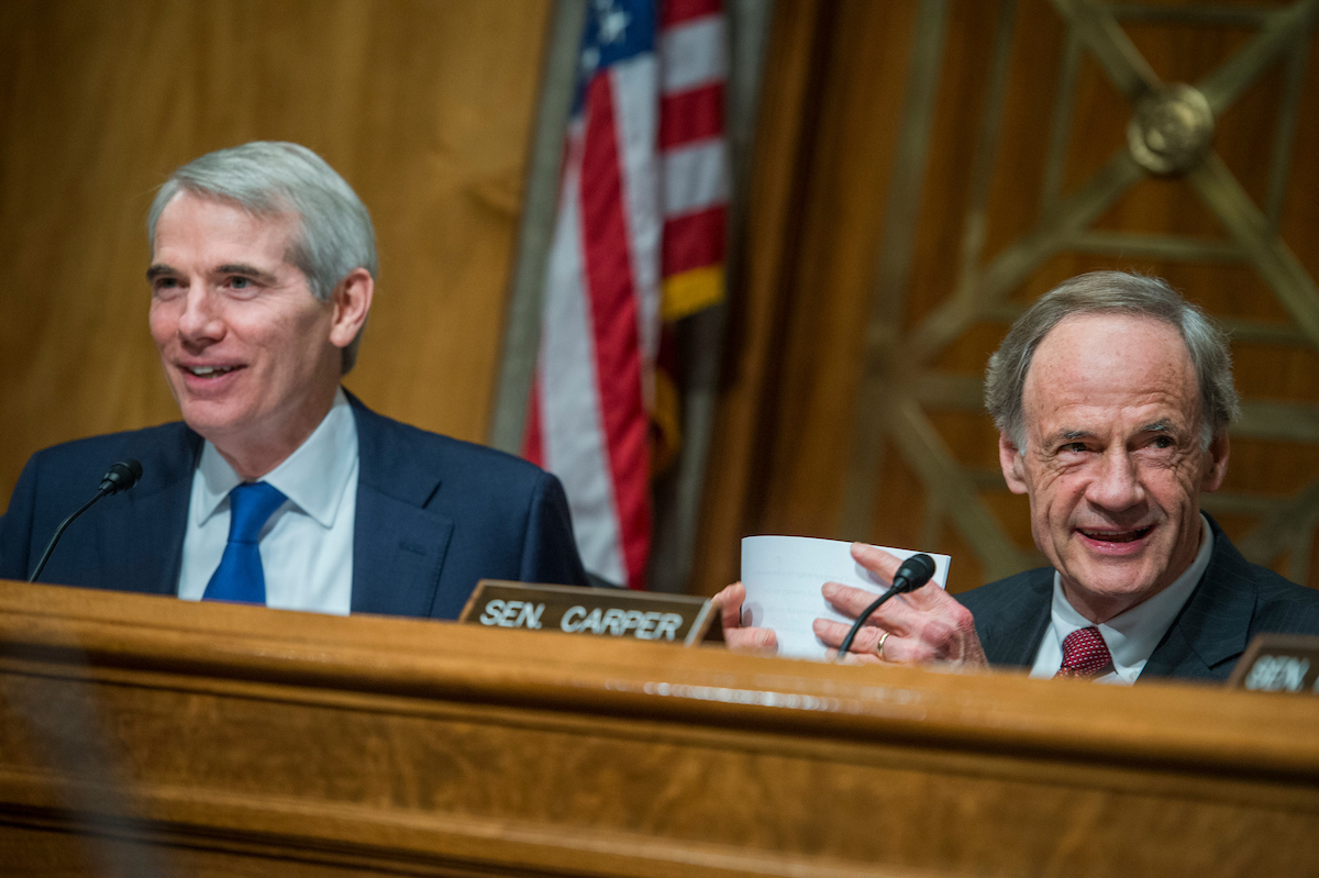 "UNITED STATES - MAY 25: Chairman Rob Portman, R-Ohio, left, and Ranking Member Tom Carper, D-Del., conduct a Senate Committee on Homeland Security and Governmental Affairs Permanent Subcommittee on Investigations hearing in Dirksen Building titled ""Stopping the Shipment of Synthetic Opioids: Oversight of U.S. Strategy to Combat Illicit Drugs"" on May 25, 2017. (Photo By Tom Williams/CQ Roll Call)"