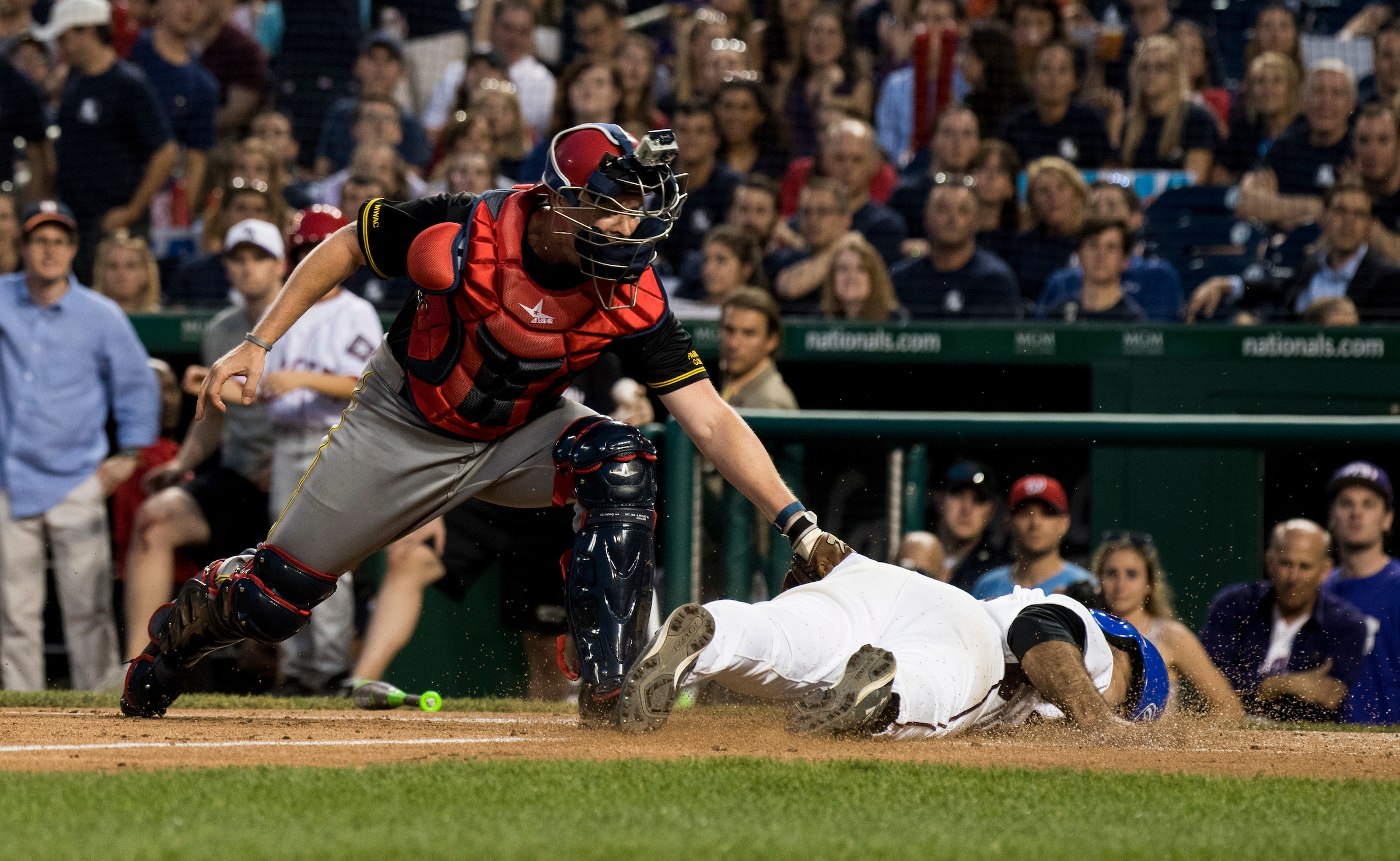 UNITED STATES - JUNE 15: Rep. Jimmy Panetta, D-Calif., slides in safe at home as GOP catcher Rep. Rodney Davis, R-Ill., tries to apply the tag during the the annual Congressional Baseball Game at Nationals Park in Washington on Thursday, June 15, 2017. (Photo By Bill Clark/CQ Roll Call)