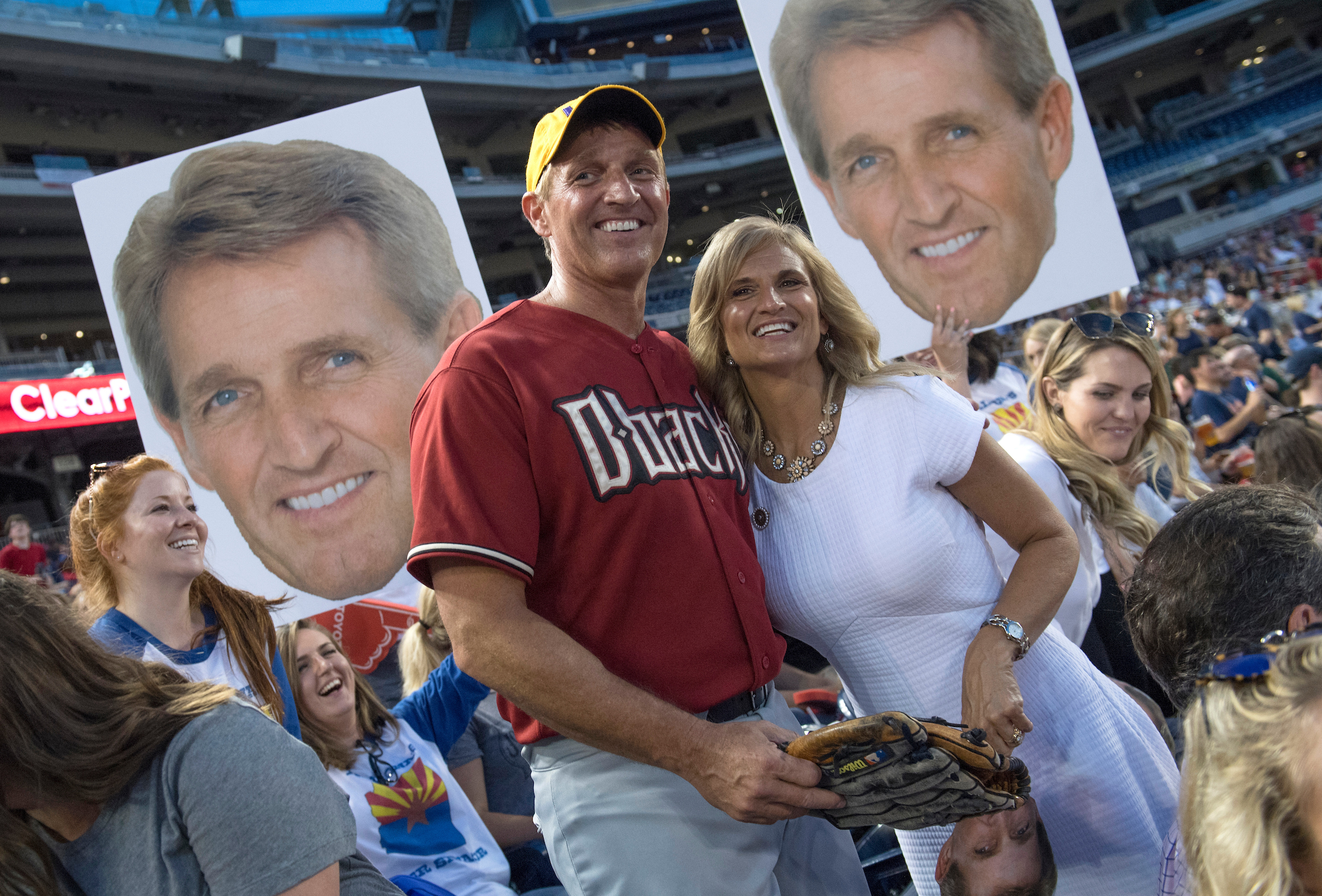 UNITED STATES - JUNE 15: Sen. Jeff Flake and his wife Cheryl are seen in the stands during the 56th Congressional Baseball Game at Nationals Park on June 15, 2017. (Photo By Tom Williams/CQ Roll Call)