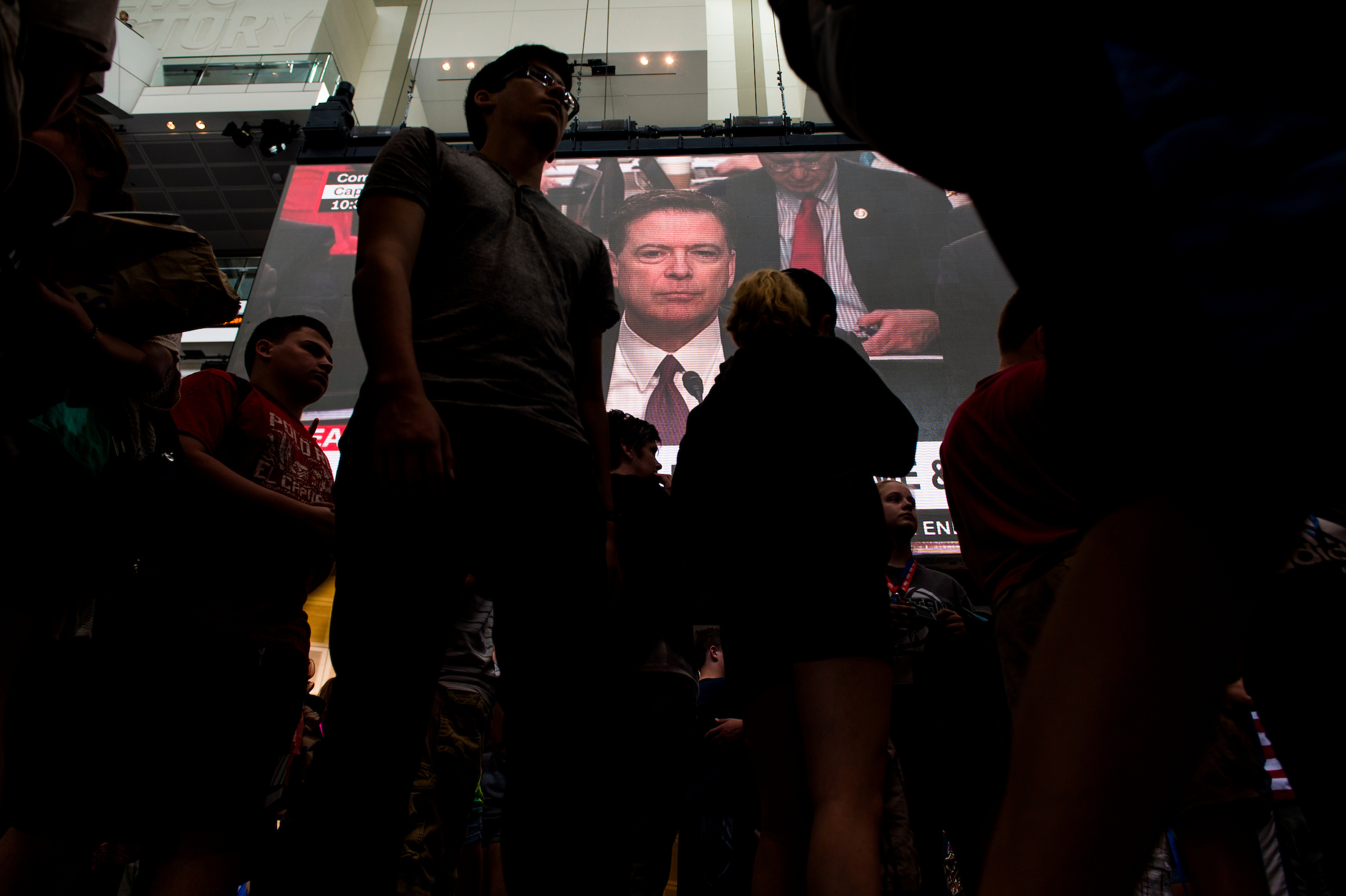 Comey is shown testifying on the Newseum's large video screen during the Senate Select Intelligence Committee hearing. (Bill Clark/CQ Roll Call)