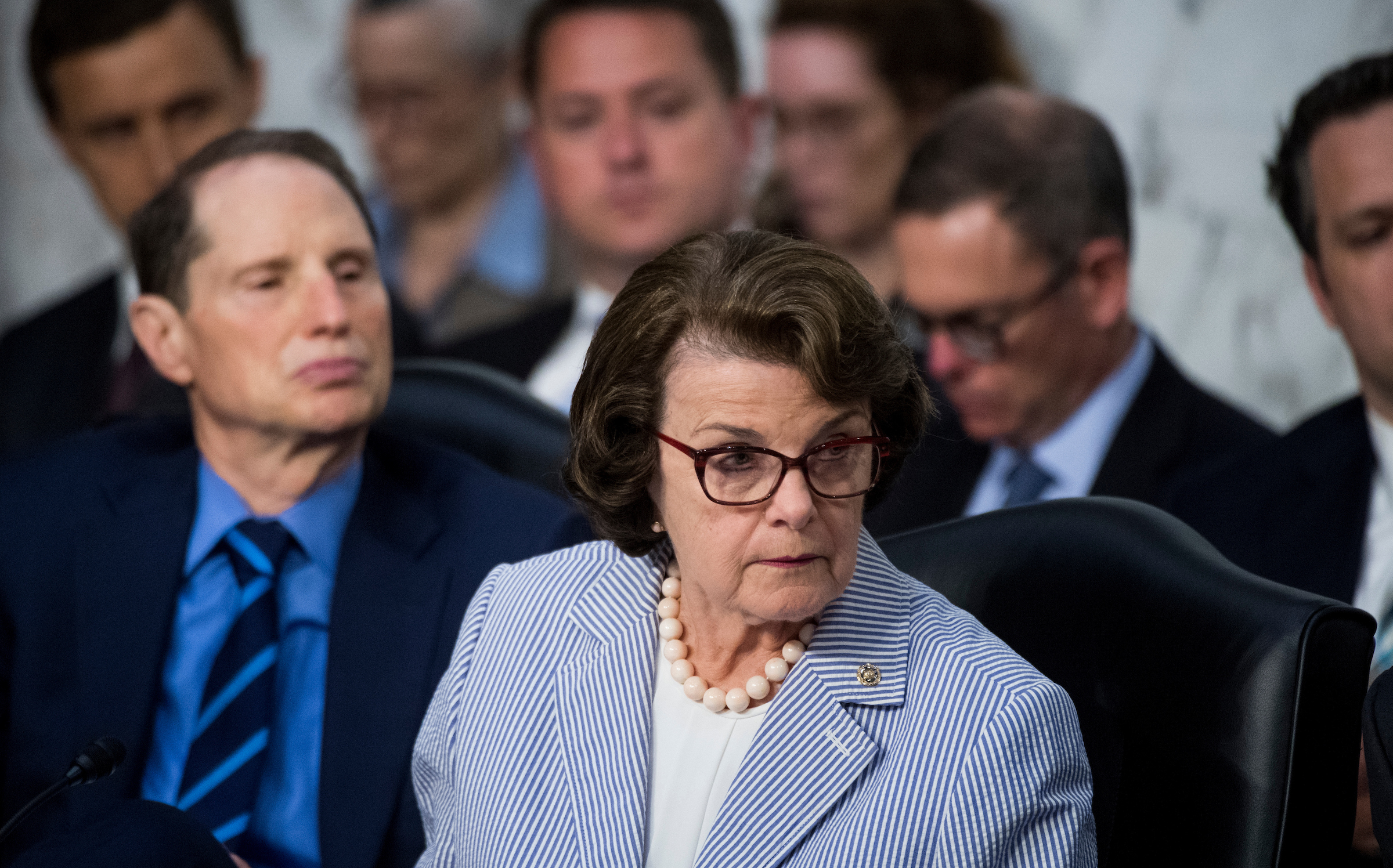 "UNITED STATES - JUNE 8: Sen. Dianne Feinstein, D-Calif., and Sen. Ron Wyden, D-Ore., listen as Republicans members question former FBI Director James Comey during the Senate Select Intelligence Committee hearing on ""Russian Federation Efforts to Interfere in the 2016 U.S. Elections"" on Thursday, June 8, 2017. (Photo By Bill Clark/CQ Roll Call)"