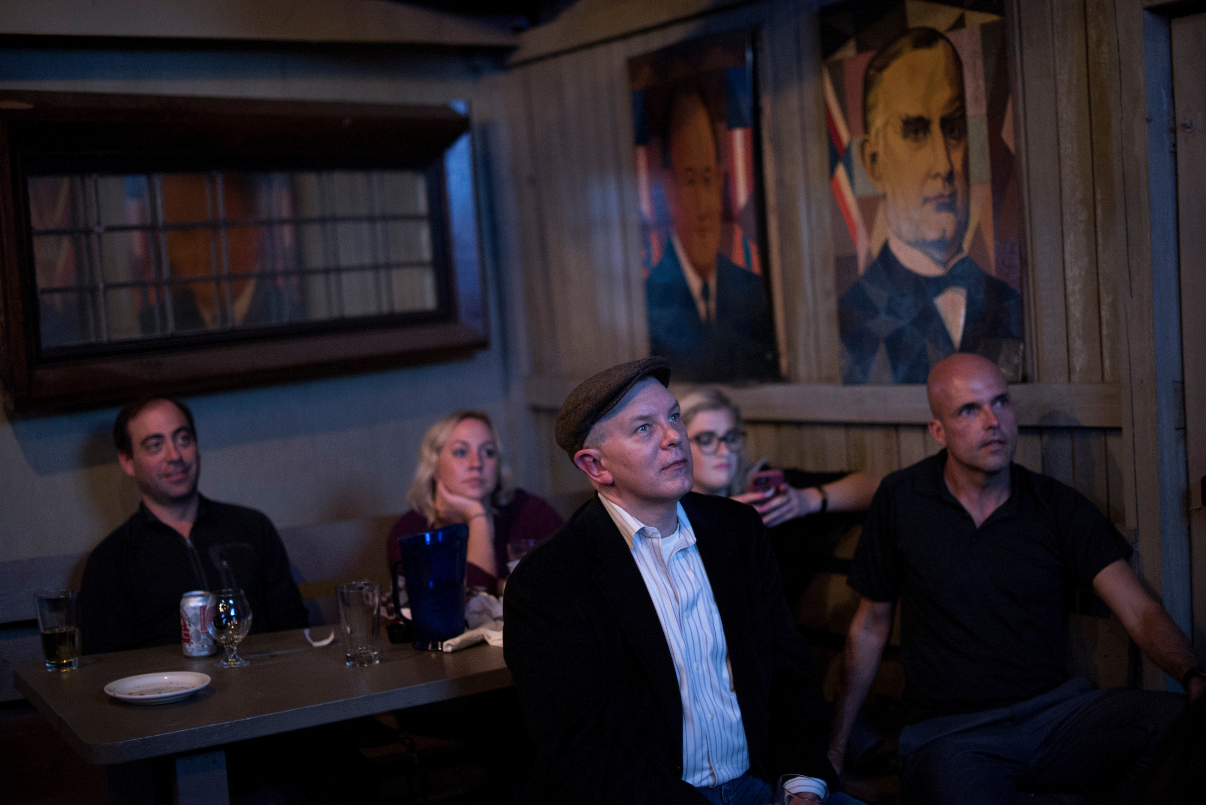Guests watch the last presidential debate in 2016 at Capitol Lounge on Pennsylvania Avenue in Washington. (Tom Williams/CQ Roll Call file photo)