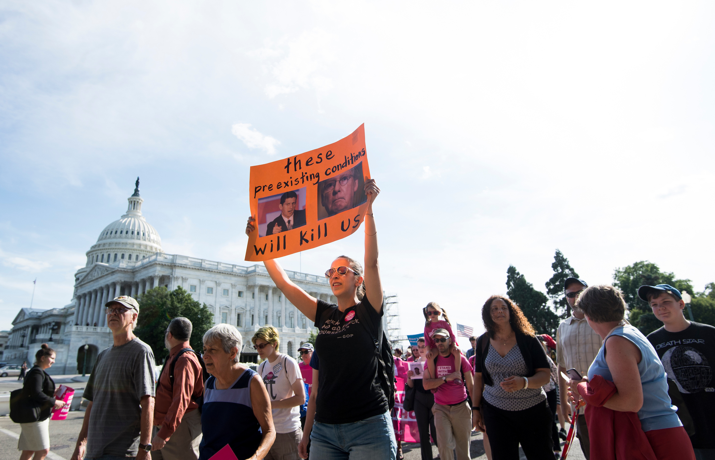 UNITED STATES - JUNE 28: Protesters march around the Capitol to voice their opposition to the GOP health care legislation on Wednesday, June 28, 2017. (Photo By Bill Clark/CQ Roll Call)