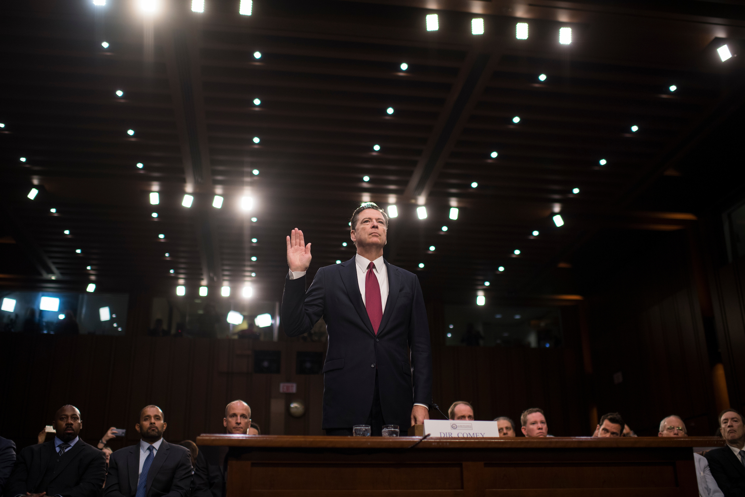 Former FBI Director James B. Comey is sworn in before testifying about President Donald Trump's possible campaign ties to Russia during a Senate Intelligence Committee hearing on Thursday. (Tom Williams/CQ Roll Call)