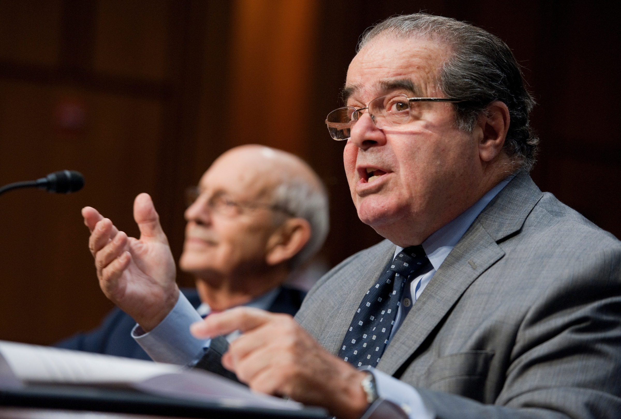 Supreme Court Justice Antonin Scalia testifies at a Senate Judiciary Committee hearing in October 2011. To his left is Justice Stephen G. Breyer. (Tom Williams/Roll Call file photo)