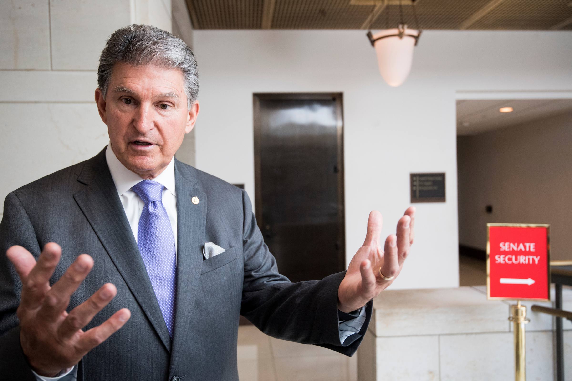 Sen. Joe Manchin, D-W. Va., speaks with reporters in the Capitol on Tuesday. (Bill Clark/CQ Roll Call)