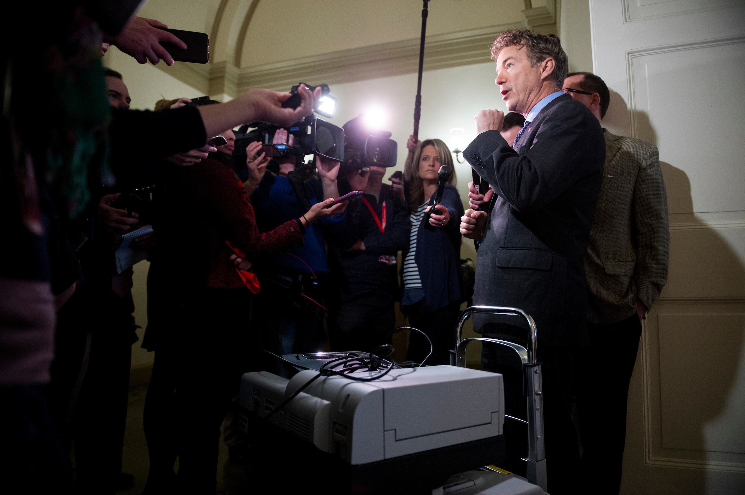 Sen. Rand Paul, R-Ky., stands with his copier on a cart as he speaks to reporters after trying to gain access to the room housing the House Republicans' secret health care plan in the Capitol on Thursday, March 2, 2017. Sen. Paul hoped to make copies of the House Republicans' health care plan. (Photo By Bill Clark/CQ Roll Call)