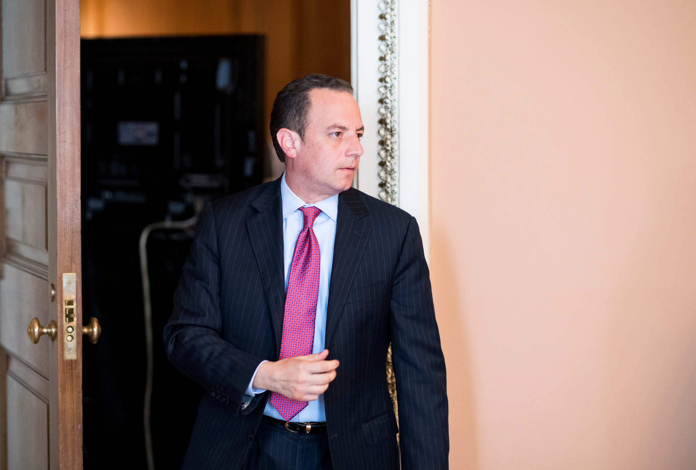 Reince Priebus, chief of staff for President Donald Trump, leaves the Senate Republicans' policy lunch in the Capitol on Tuesday. (Bill Clark/CQ Roll Call)