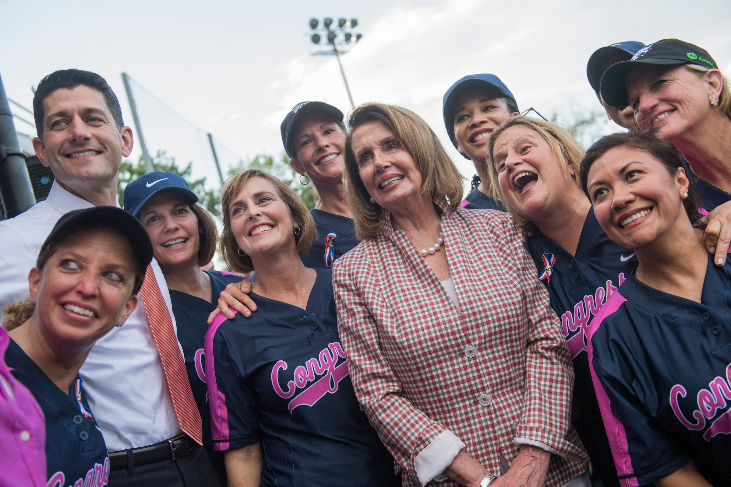UNITED STATES - JUNE 21: Speaker of the House Paul Ryan, R-Wis., and House Minority Leader Nancy Pelosi, D-Calif., pose with the members team before the Congressional Women's Softball game that pits Congresswomen against female journalists at Watkins Recreation Center on Capitol Hill, June 21, 2017. The game benefits the Young Survival Coalition that helps young women with breast cancer. The press team prevailed 2-1. (Photo By Tom Williams/CQ Roll Call)