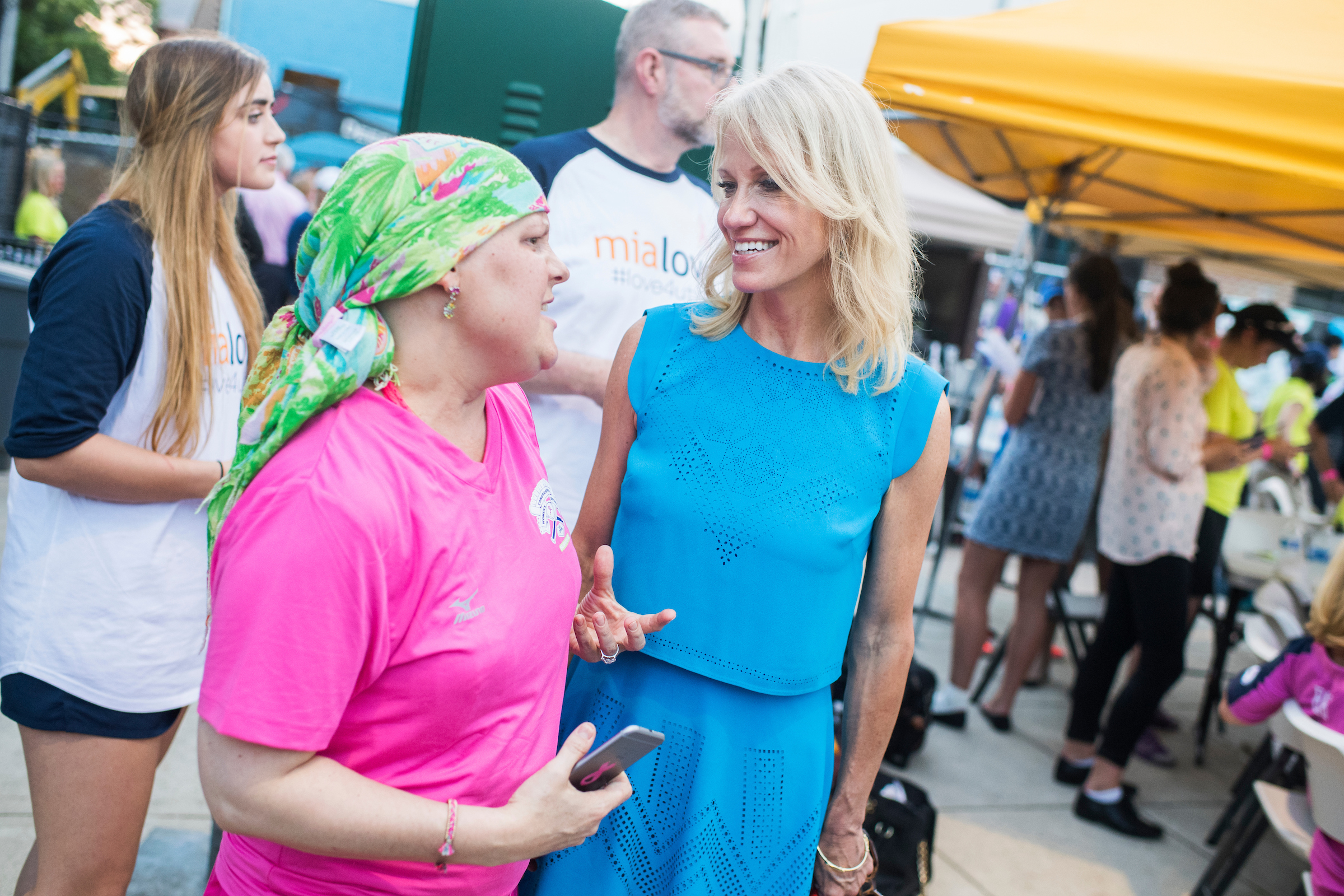 UNITED STATES - JUNE 21: Kellyanne Conway, right, talks with a guest during the Congressional Women's Softball game that pits Congresswomen against female journalists at Watkins Recreation Center on Capitol Hill, June 21, 2017. The game benefits the Young Survival Coalition that helps young women with breast cancer. The press team prevailed 2-1. (Photo By Tom Williams/CQ Roll Call)