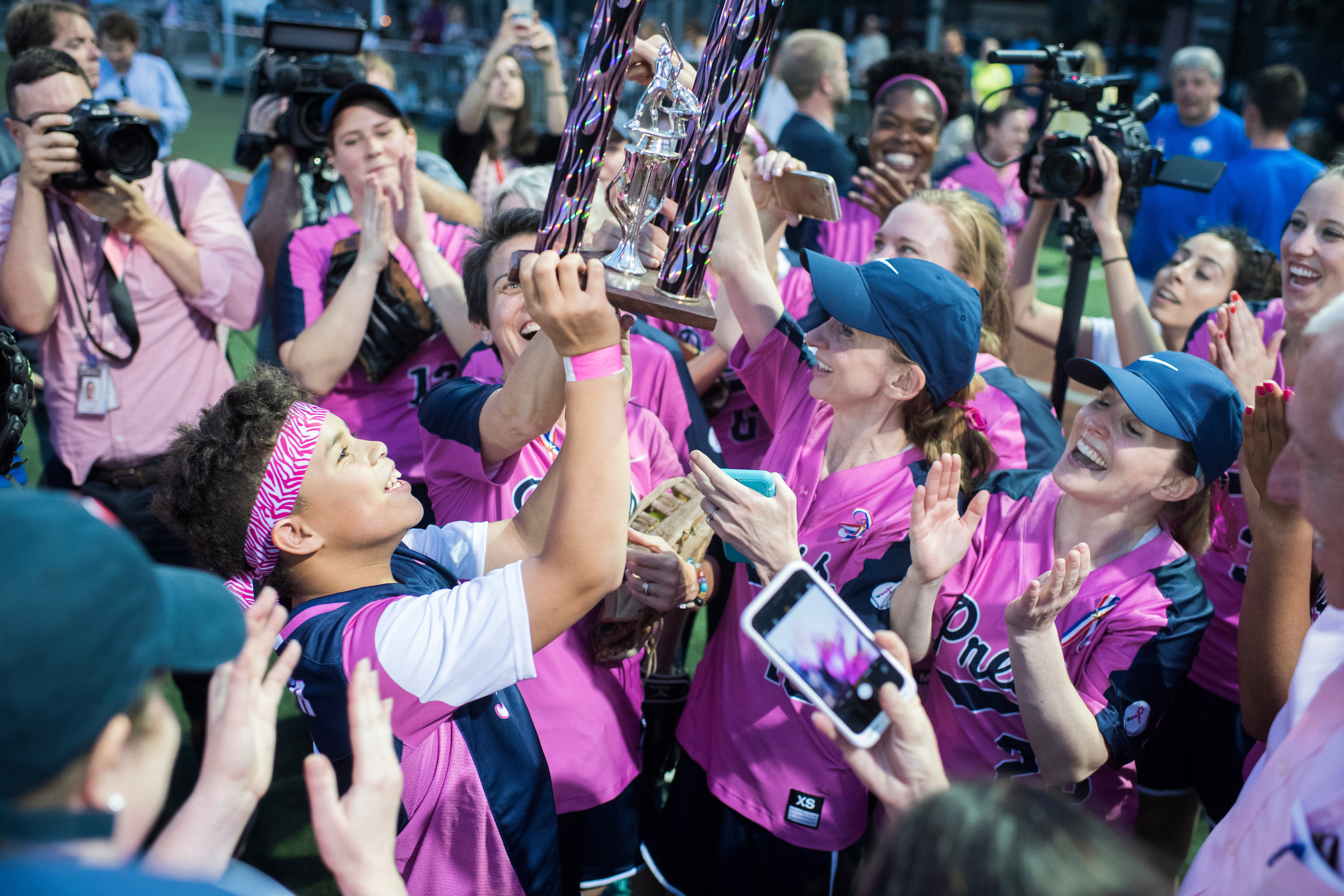 UNITED STATES - JUNE 21: The press team celebrates a 2-1 victory in the Congressional Women's Softball game that pits Congresswomen against female journalists at Watkins Recreation Center on Capitol Hill, June 21, 2017. The game benefits the Young Survival Coalition that helps young women with breast cancer. (Photo By Tom Williams/CQ Roll Call)