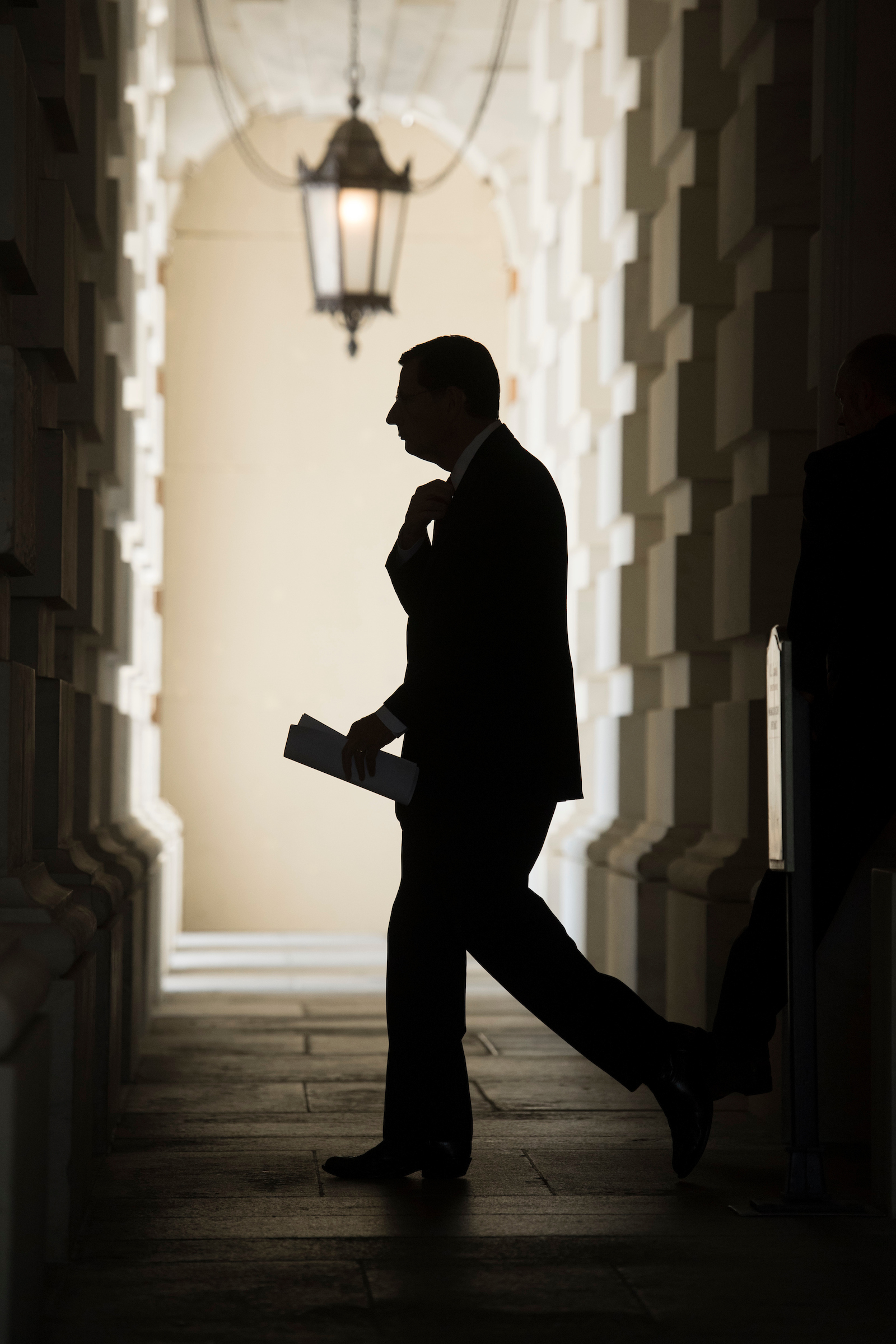 Sen. John Barrasso, R-Wyo., leaves the Capitol before boarding a bus to bring Republican senators to lunch at the White House with President Trump to discuss the health care plan on July 19, 2017. (Photo By Tom Williams/CQ Roll Call)