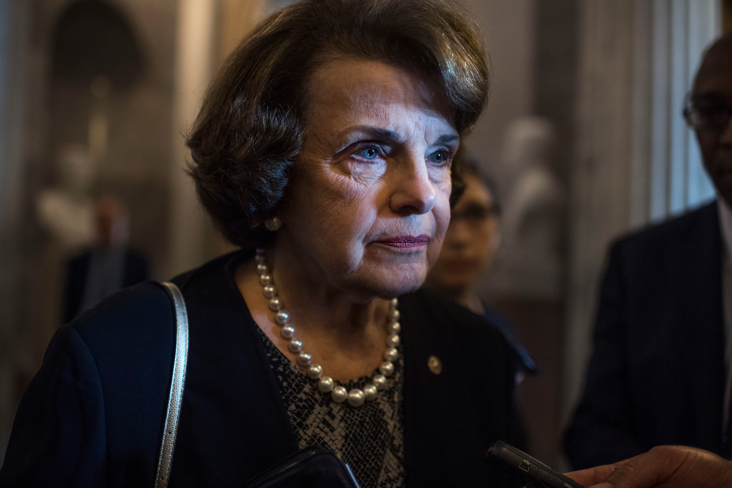 UNITED STATES - JULY 18: Sen. Dianne Feinstein, D-Calif., talks with reporters before the Senate Policy Luncheons in the Capitol on July 18, 2017. (Photo By Tom Williams/CQ Roll Call)