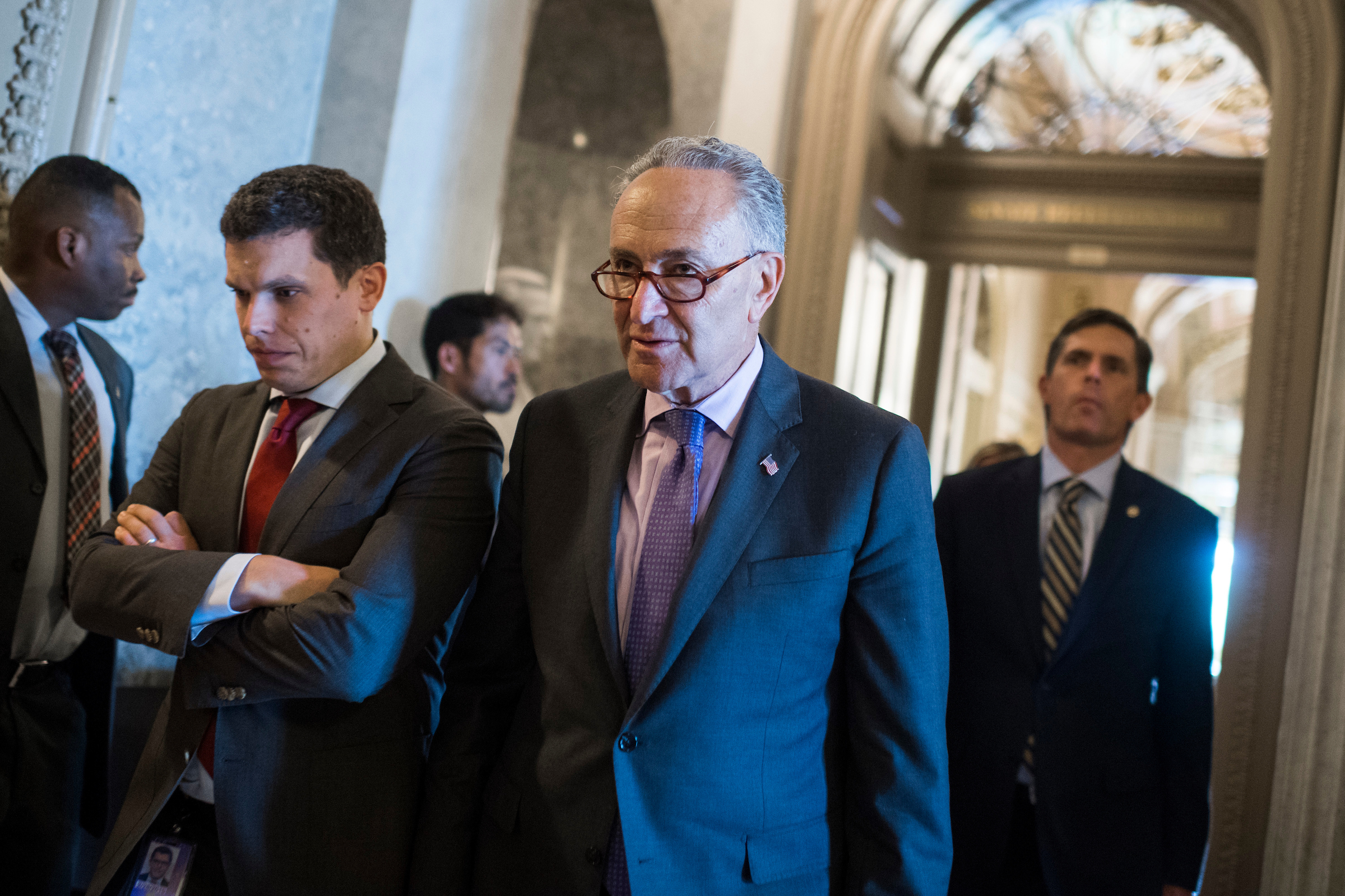 UNITED STATES - JULY 18: Senate Minority Leader Charles Schumer, D-N.Y., makes his way to a news conference after the Senate Policy Luncheons in the Capitol on July 18, 2017. (Photo By Tom Williams/CQ Roll Call)