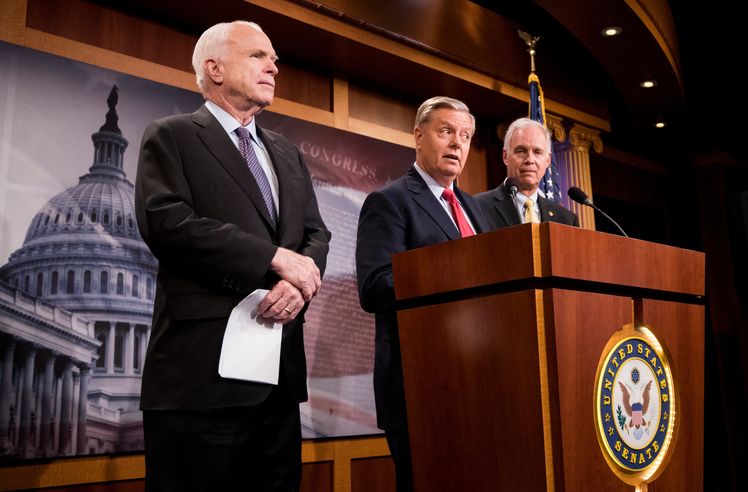 "Sens. John McCain, R-Ariz., Lindsey Graham, R-S.C., and Ron Johnson, R-Wis., hold a press conference to demand assurances on the ""skinny"" health care repeal bill in the Capitol on Thursday.(Bill Clark/CQ Roll Call)"
