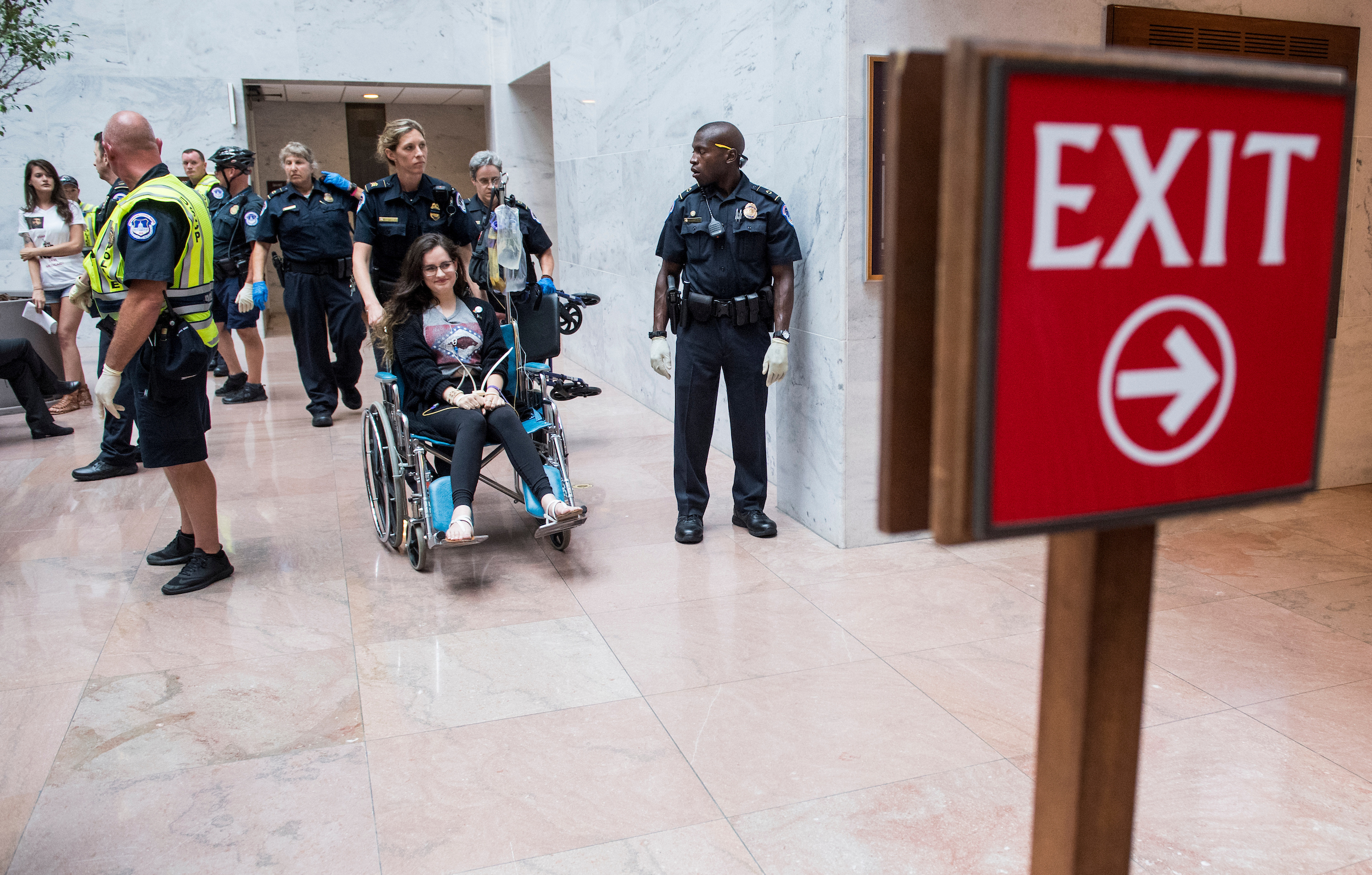 UNITED STATES - JULY 10: Capitol Police arrest health care protesters from Arkansas who were chanting outside of the office of Sen. John Boozman, R-Ark., in the Hart Senate Office Building on Monday, July 10, 2017. Protests popped up at several Senate Republican offices on Capitol Hill on Monday. (Photo By Bill Clark/CQ Roll Call)