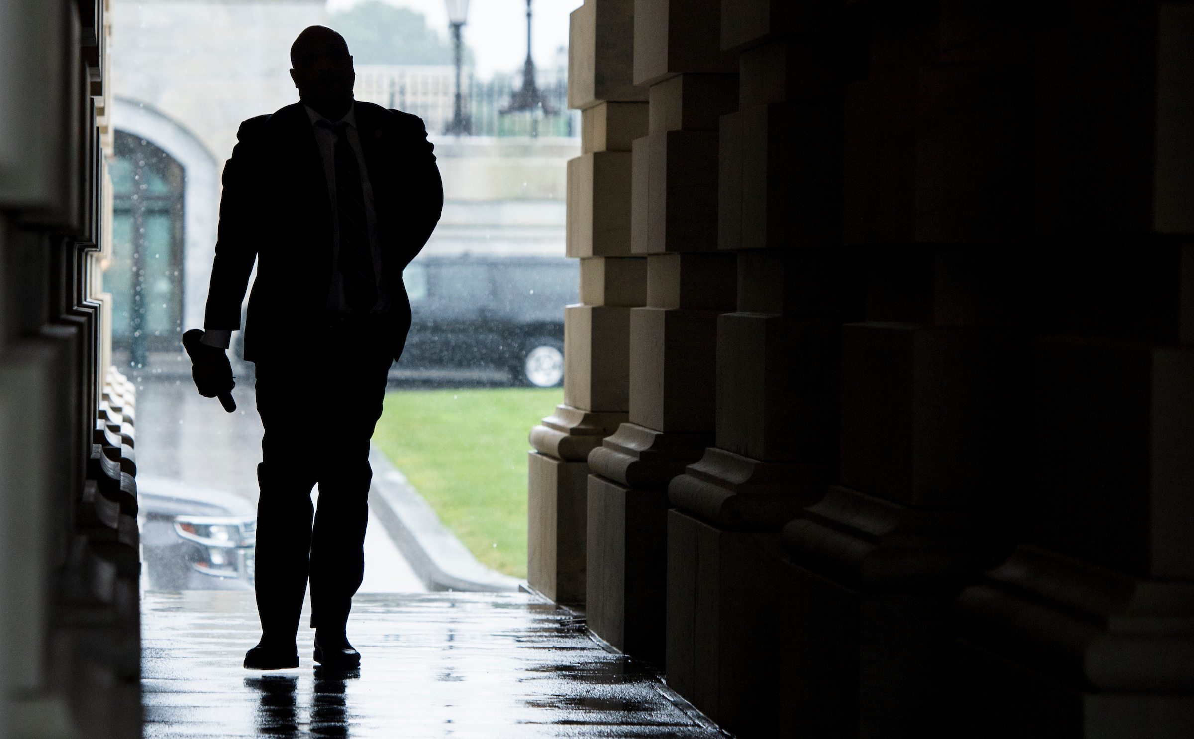 UNITED STATES - JULY 28: Rep. Andre Carson, D-Ind., walks to the covered carriage entrance of the Capitol during a rain storm for the final votes before Congress leaves town for their summer recess on Friday, July 28, 2017. (Photo By Bill Clark/CQ Roll Call)