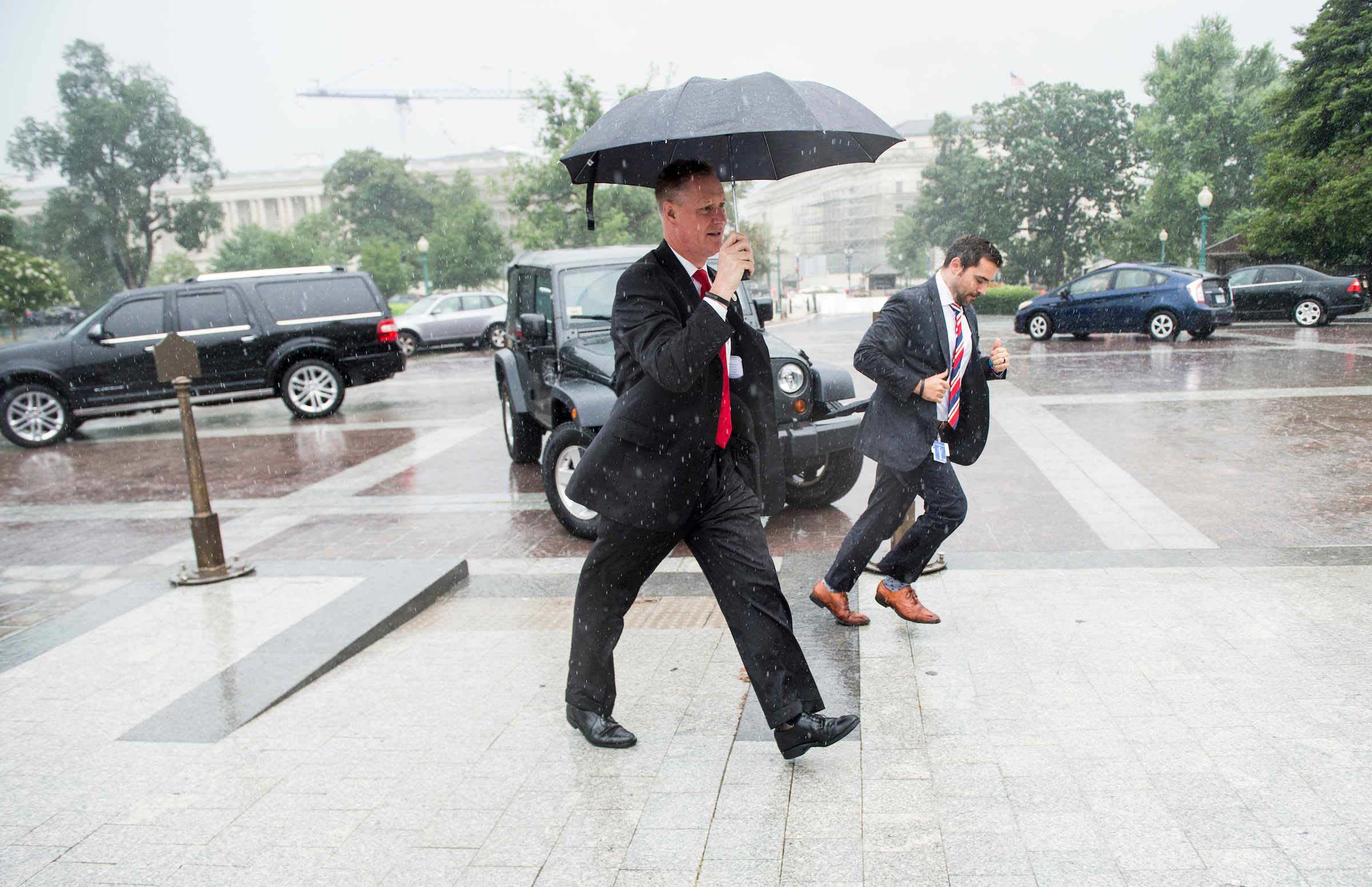 UNITED STATES - JULY 28: Rep. Steve Stivers, R-Ohio, walks up the House steps in the rain for the final votes before Congress leaves town for their summer recess on Friday, July 28, 2017. (Photo By Bill Clark/CQ Roll Call)