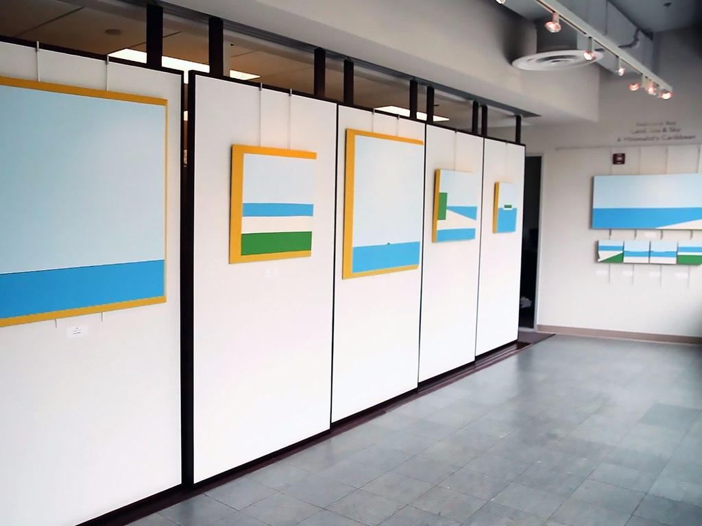 "Ruiz's show, ""Land, Sea & Sky: A Minimalist's Caribbean,"" is hanging through July in Glen Echo Park. (Screenshot)"