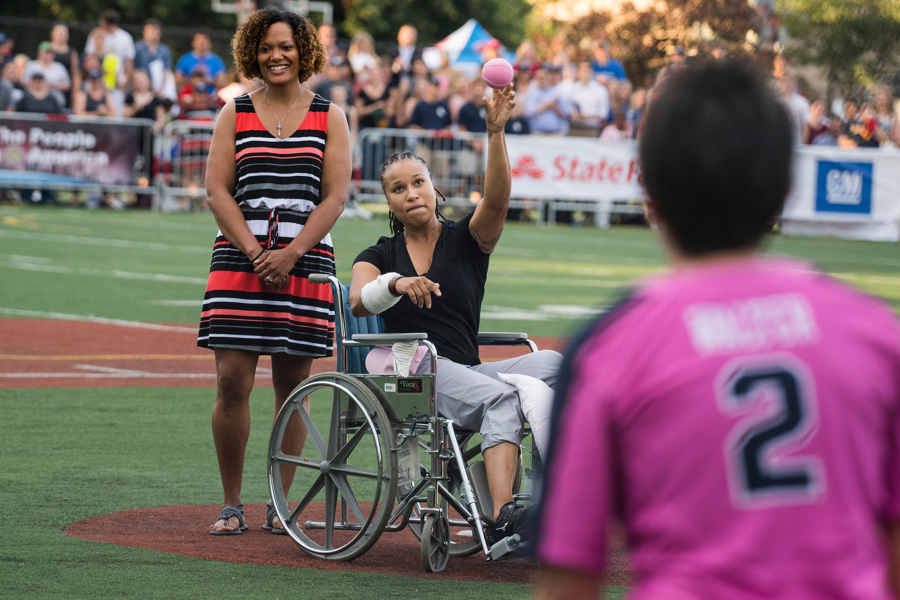 JUNE 21: Capitol Police officer Crystal Griner throws out the first pitch in the Congressional Women's Softball game that pits congresswomen against female journalists at Watkins Recreation Center on Capitol Hill. Griner was injured in last week's shooting at the Republican baseball practice. The game benefits the Young Survival Coalition that helps young women with breast cancer. (Tom Williams/CQ Roll Call)
