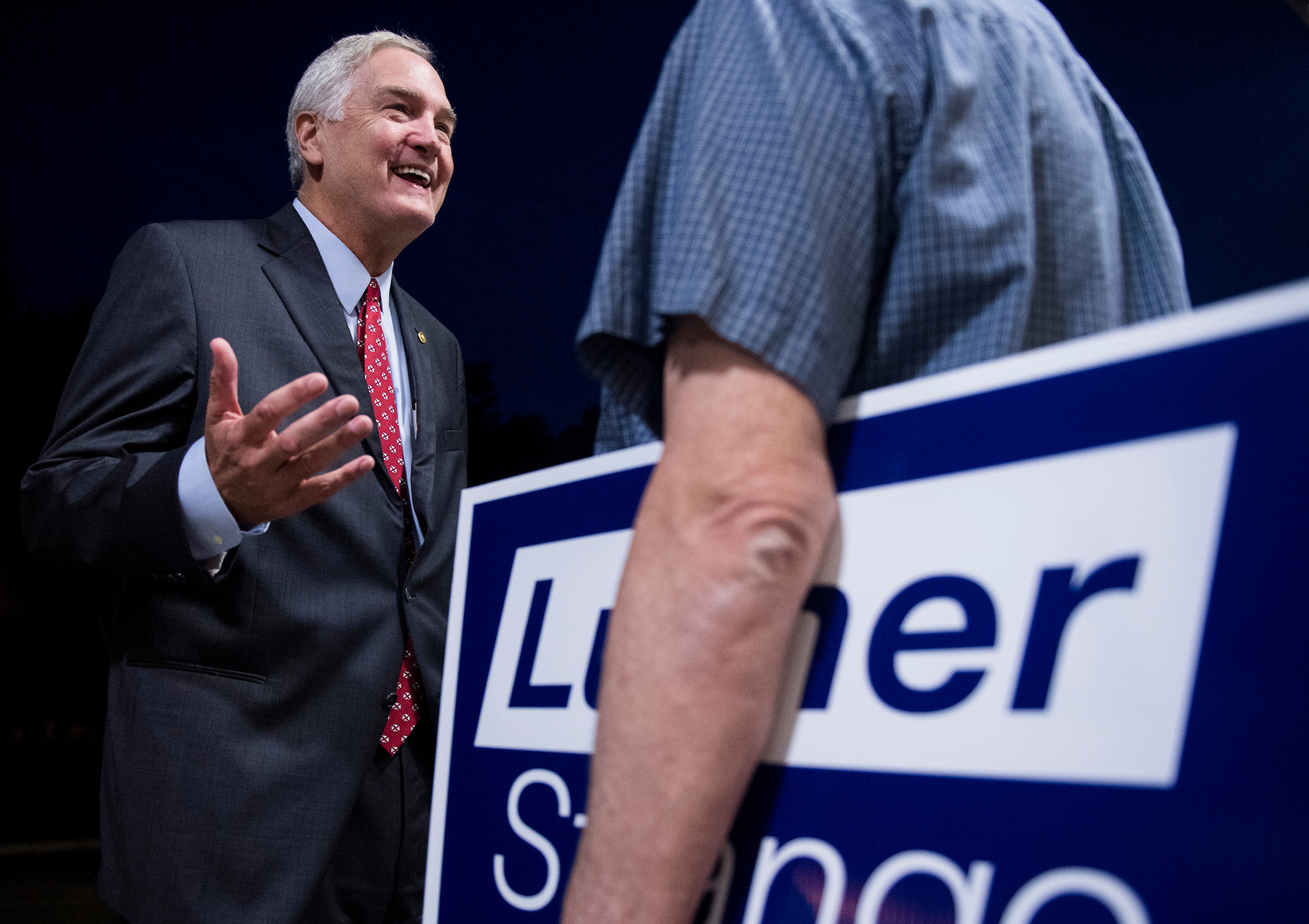 GOP candidate for U.S. Senate Sen. Luther Strange, R-Ala., left, speaks with a supporter after the U.S. Senate candidate forum held by the Shelby County Republican Party in Pelham, Ala., on Friday, Aug. 4, 2017. Sen. Strange is running in the special election to fill the seat vacated by Attorney General Jeff Sessions. (Bill Clark/CQ Roll Call)