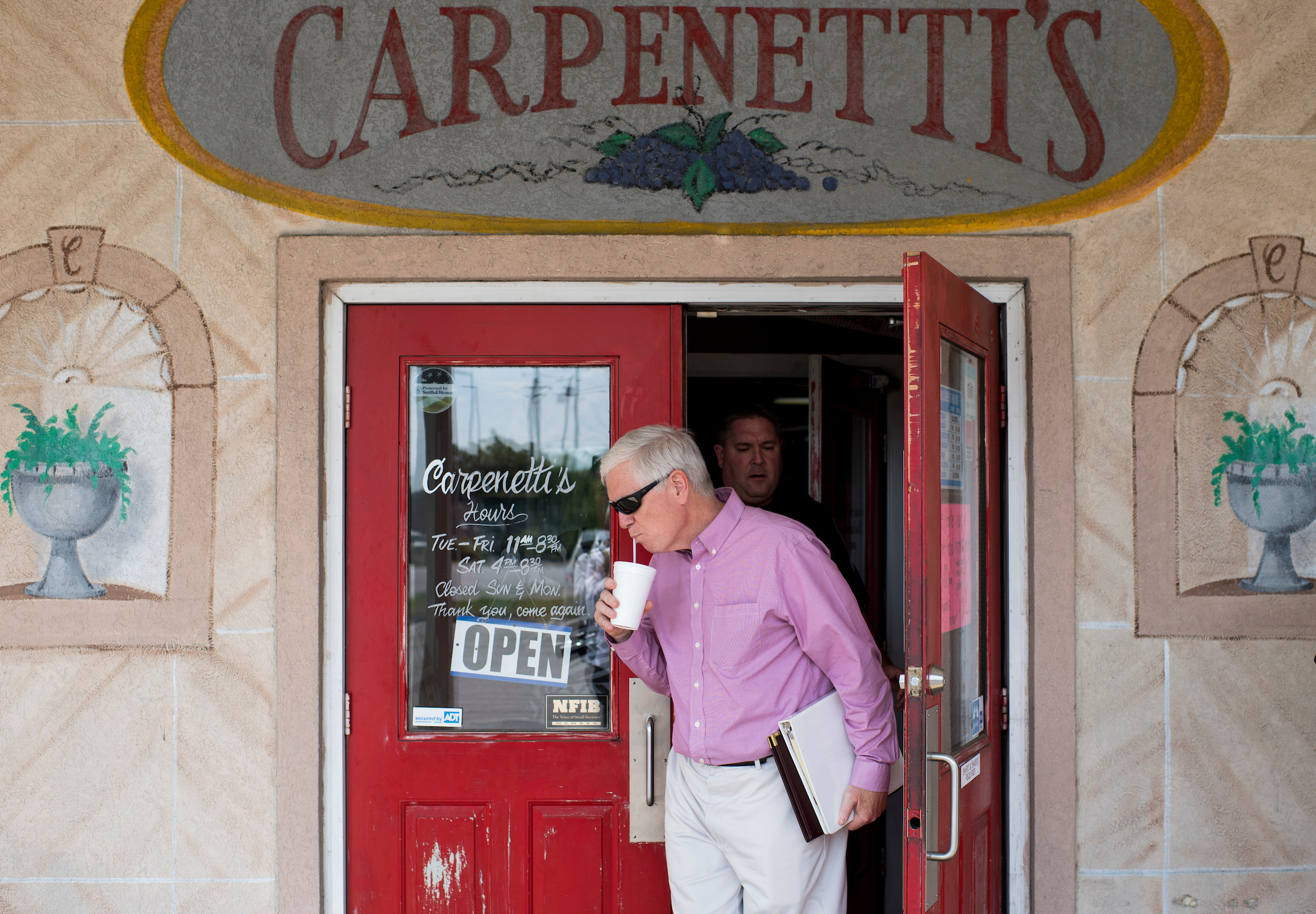 GOP candidate for U.S. Senate Rep. Mo Brooks, R-Ala., leaves Carpenetti's Pizza in Moody, Ala., after speaking with supporters at a stop on his campaign bus tour on Friday, Aug. 4, 2017. (Bill Clark/CQ Roll Call)