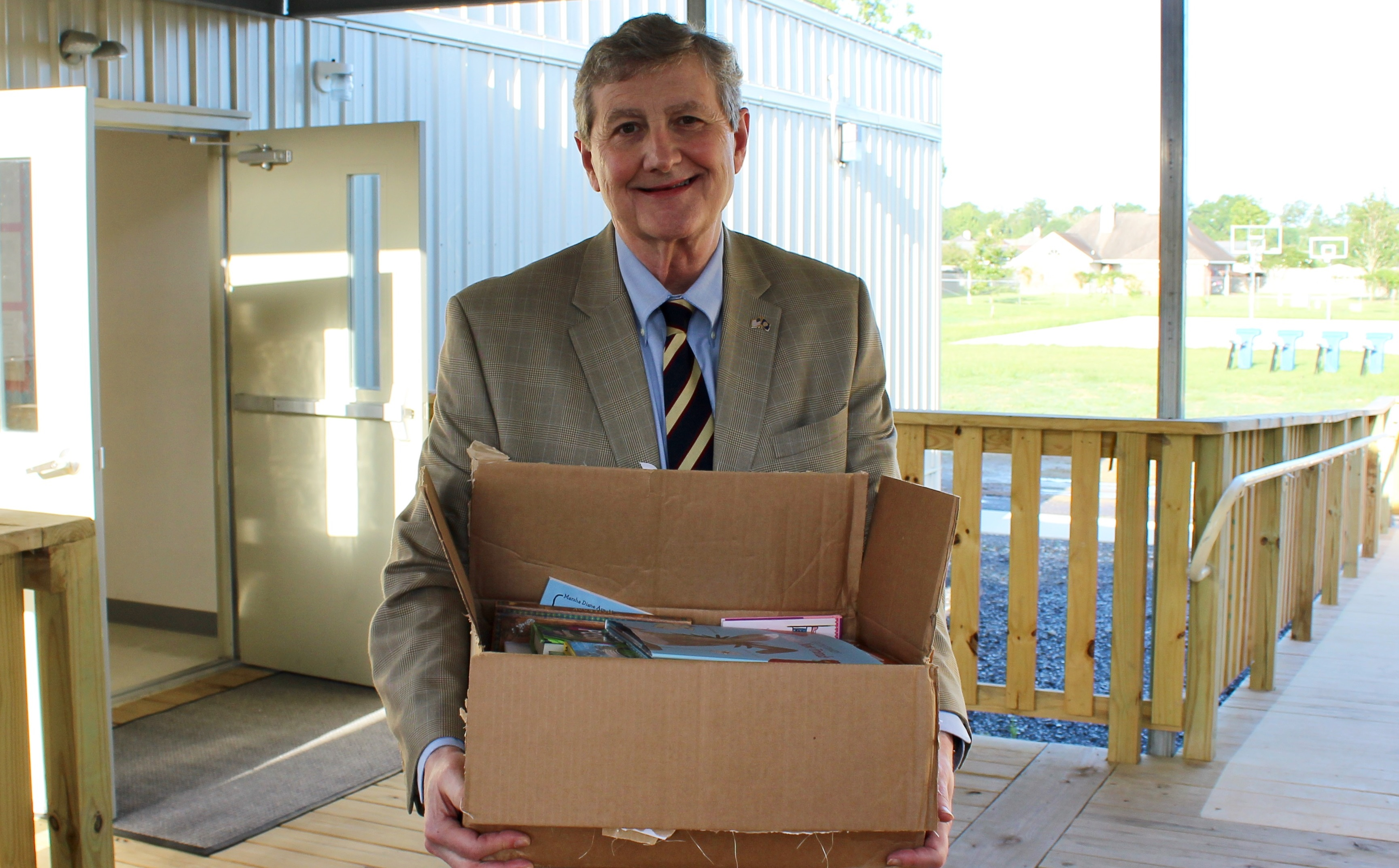 Sen. John Kennedy, R-La., with holding the box of books is one of the boxes of books he picked out from the Library of Congress to be donated to Southside Middle School . (Courtesy Kennedy)