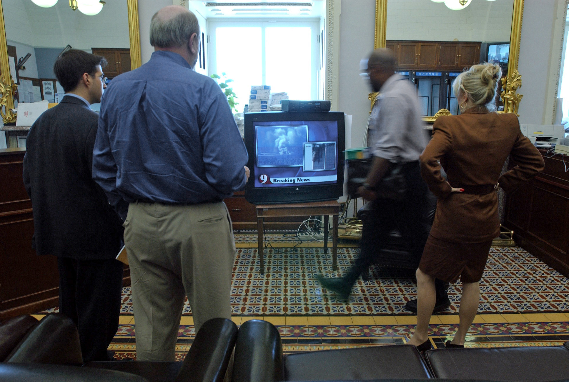 Staffers watch newscasts in the Senate Press Gallery shortly before the evacuation. Tom Williams/CQ Roll Call File Photo